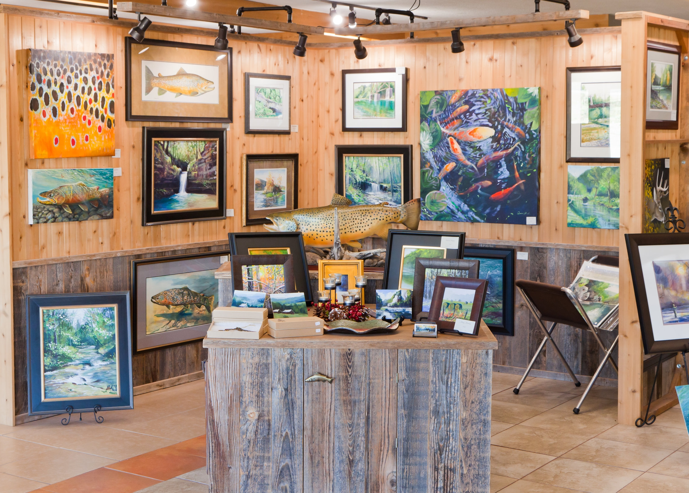 The gallery is filled with outdoor-themed art that ranges from paintings to carvings to chairs. Rivertown Gallery is located at 3512 US-62 in Mountain Home.
