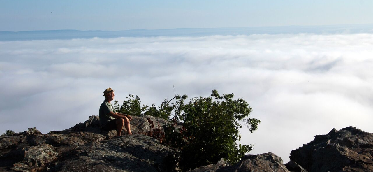 Bob Robinson takes a break from driving and looks out over the River Valley after arriving at Petit Jean Mountain State Park in Morrilton.
