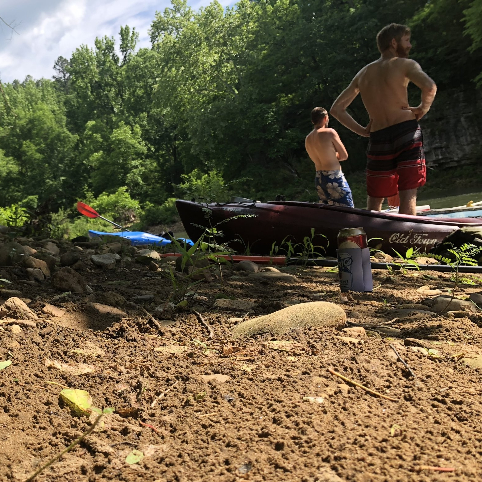 Richard Vaerewyck and Pedro Ardapple pause in their exploration of the Buffalo River to supervise as others in the group try each other's boats