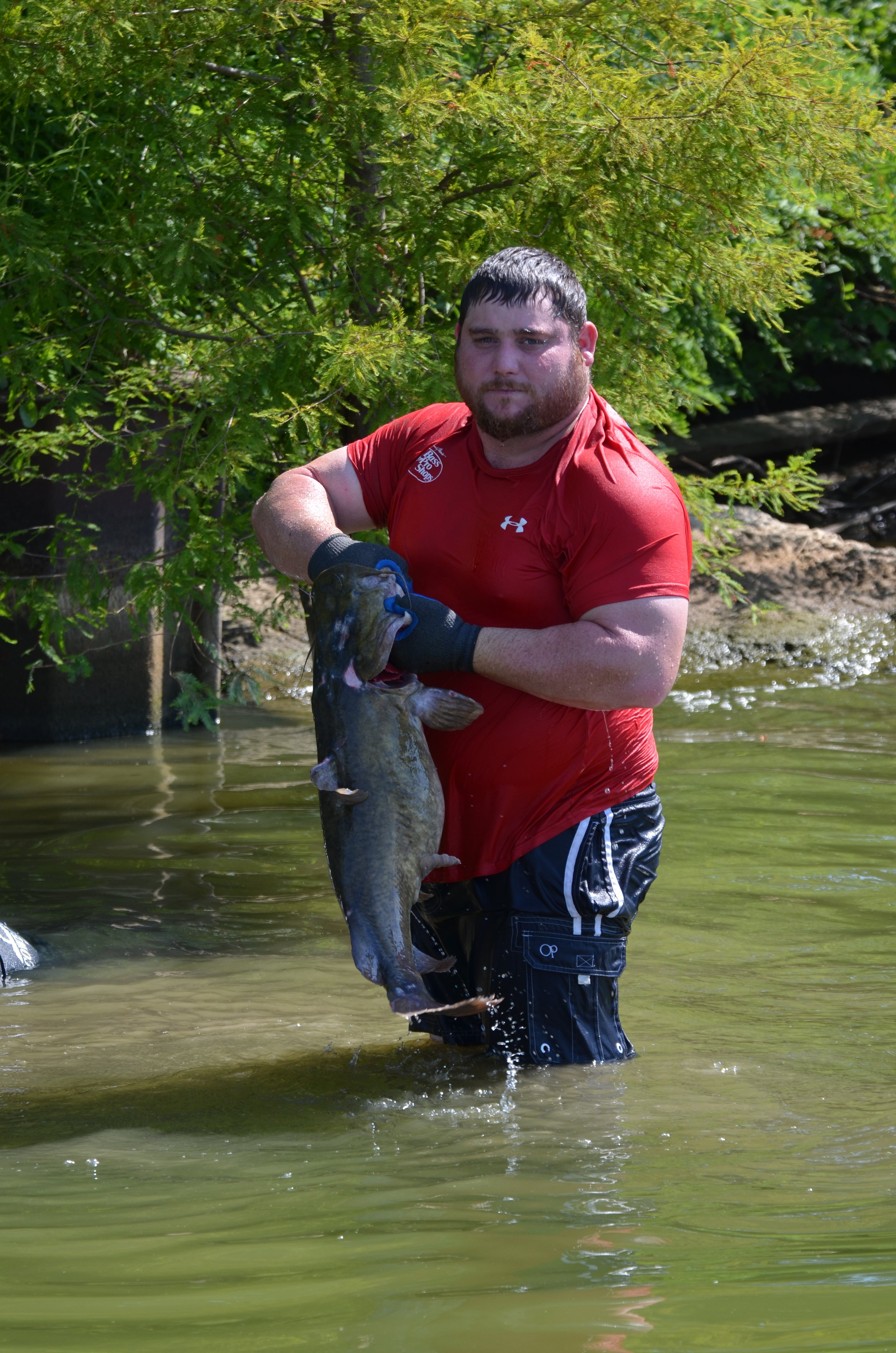 Adam Weaver holds a fresh-caught 20-pound flathead hauled from its lair.