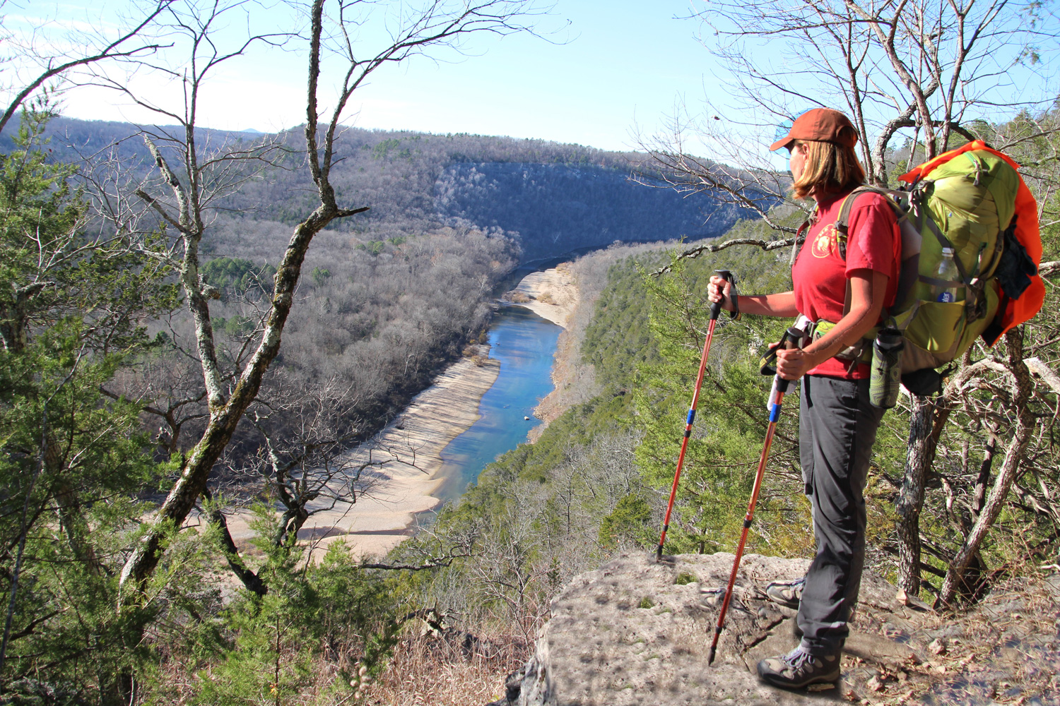 High atop Kimball Bluff, Stacy Price pauses for a view of the river along the Buffalo River Trail.