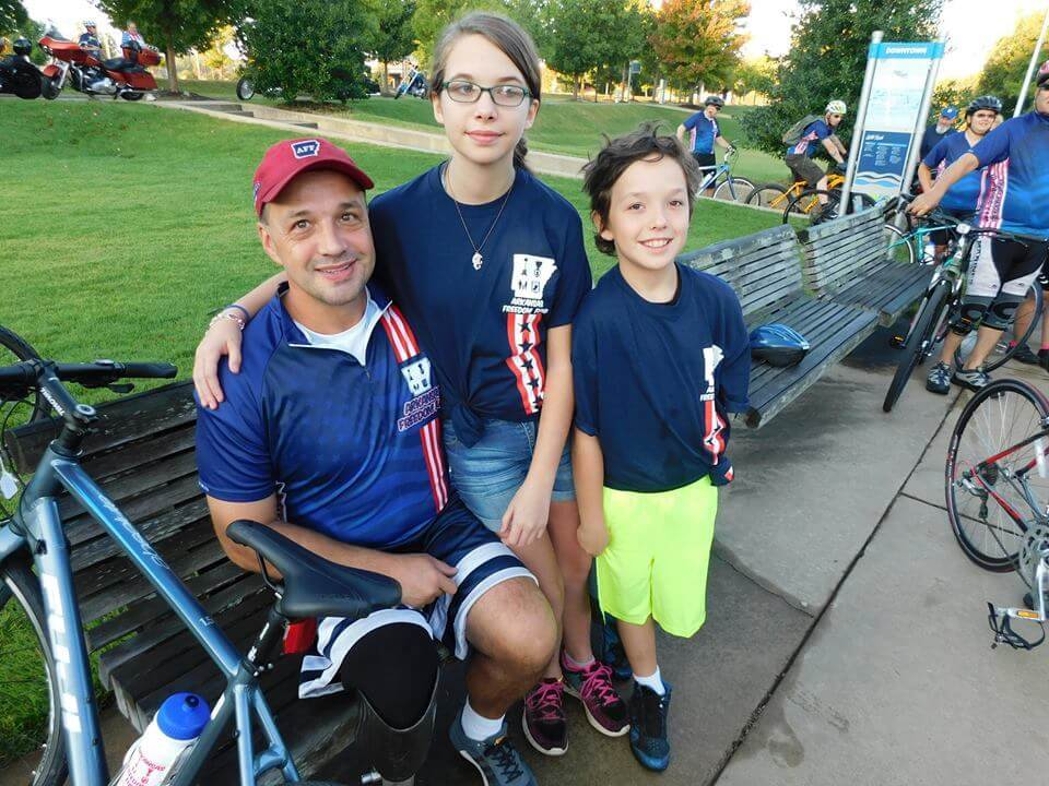 "Navy veteran Jason Lentz of Fort Smith, with his kids Brianna and Zachary at the Arkansas Challenge bike ride in Little Rock, credits AFF with getting him ""off the couch."" - Photo courtesy of: Arkansas Freedom Fund"
