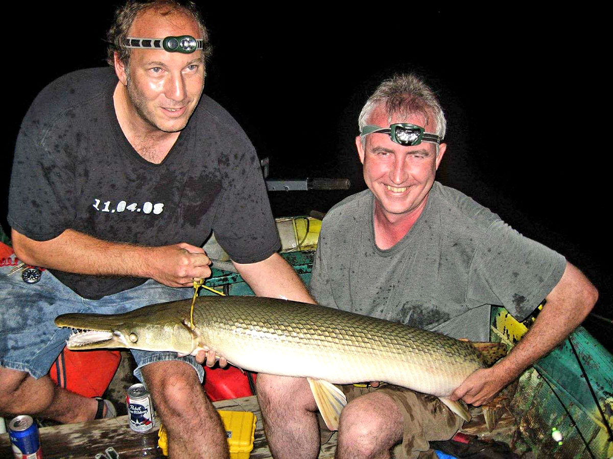 """Author Mark """"Hollywood"""" Spitzer, left, shows off a prize specimen with fishing partner Ben """"Minnow Bucket"""" Damgaard."""