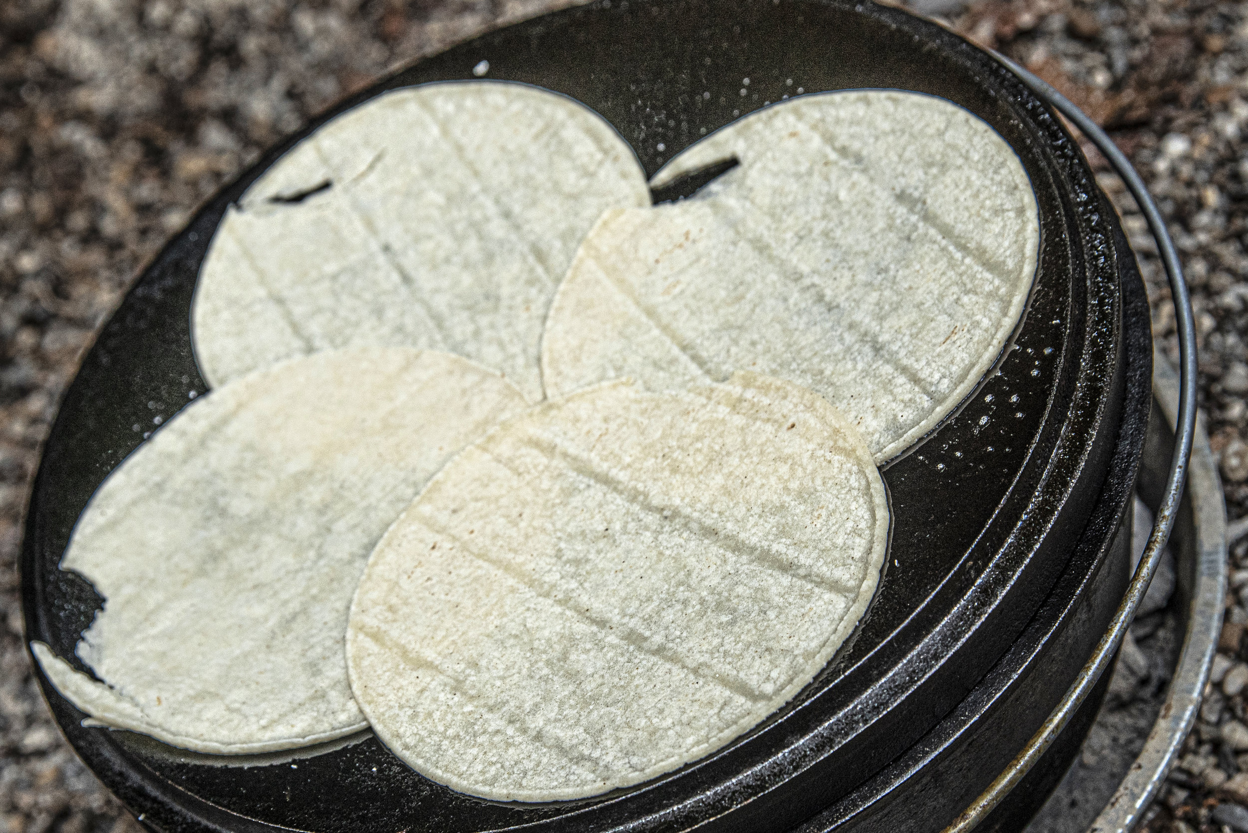 Warm your tortillas on the Dutch oven lid.