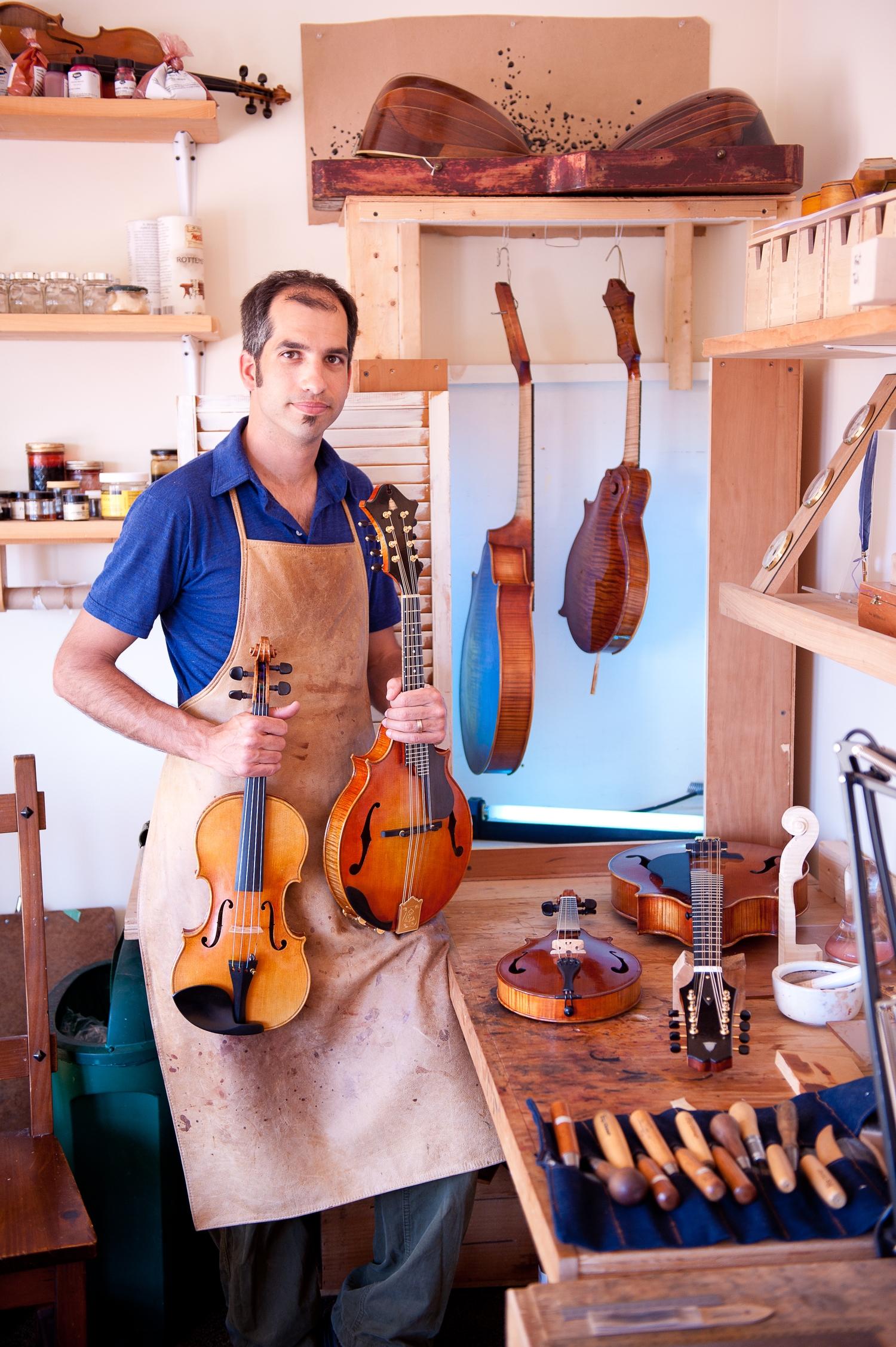 Model's Shown (L-R): Guarneri Model violin, Dué Mandolin, Dué mandola, F-5 Mandolin. Workbench: Dué Piccolo Mandolin, Dué Octave mandolin.