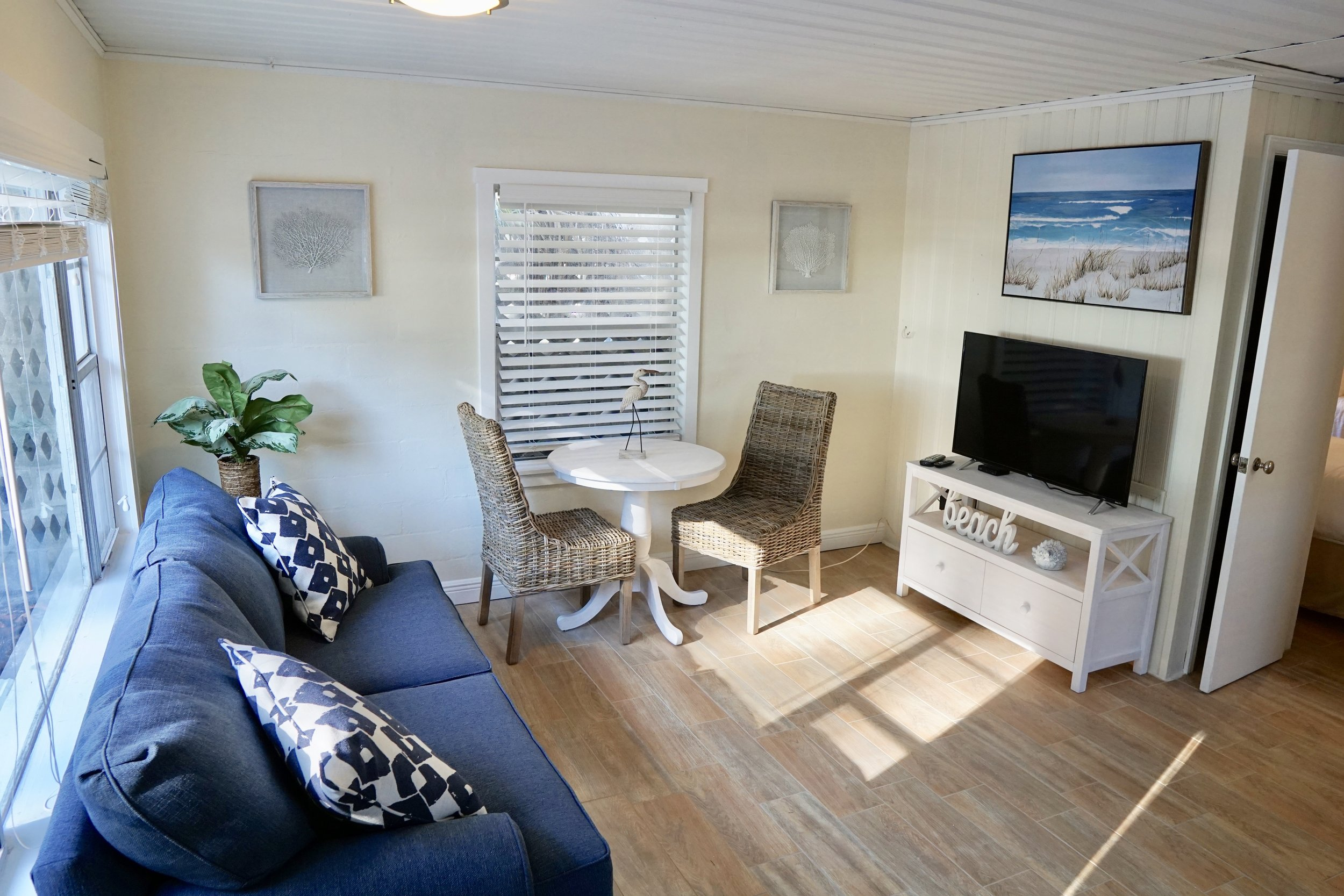 One-Bedroom Cottage: Gulf View - The cottages feature the same layout as the One-Bedroom Suites. The room comes with one full and one twin bed. The cottages are their own structure separate from the main building.
