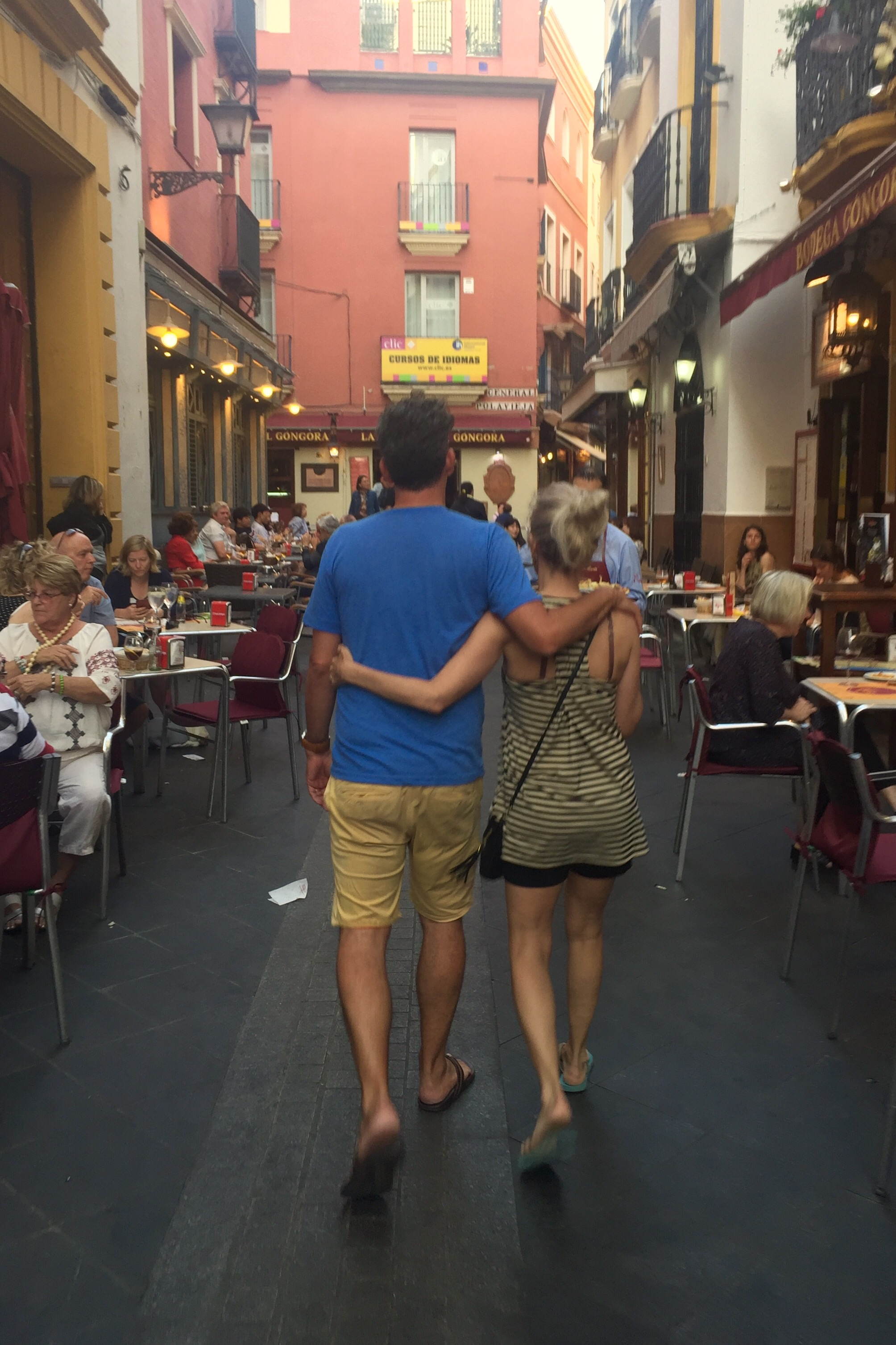 Cute couple heading to tapas alley