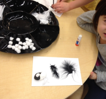 Simple materials inspire our imaginations when we make black and white creatures: pompoms, feathers, black and white model magic.
