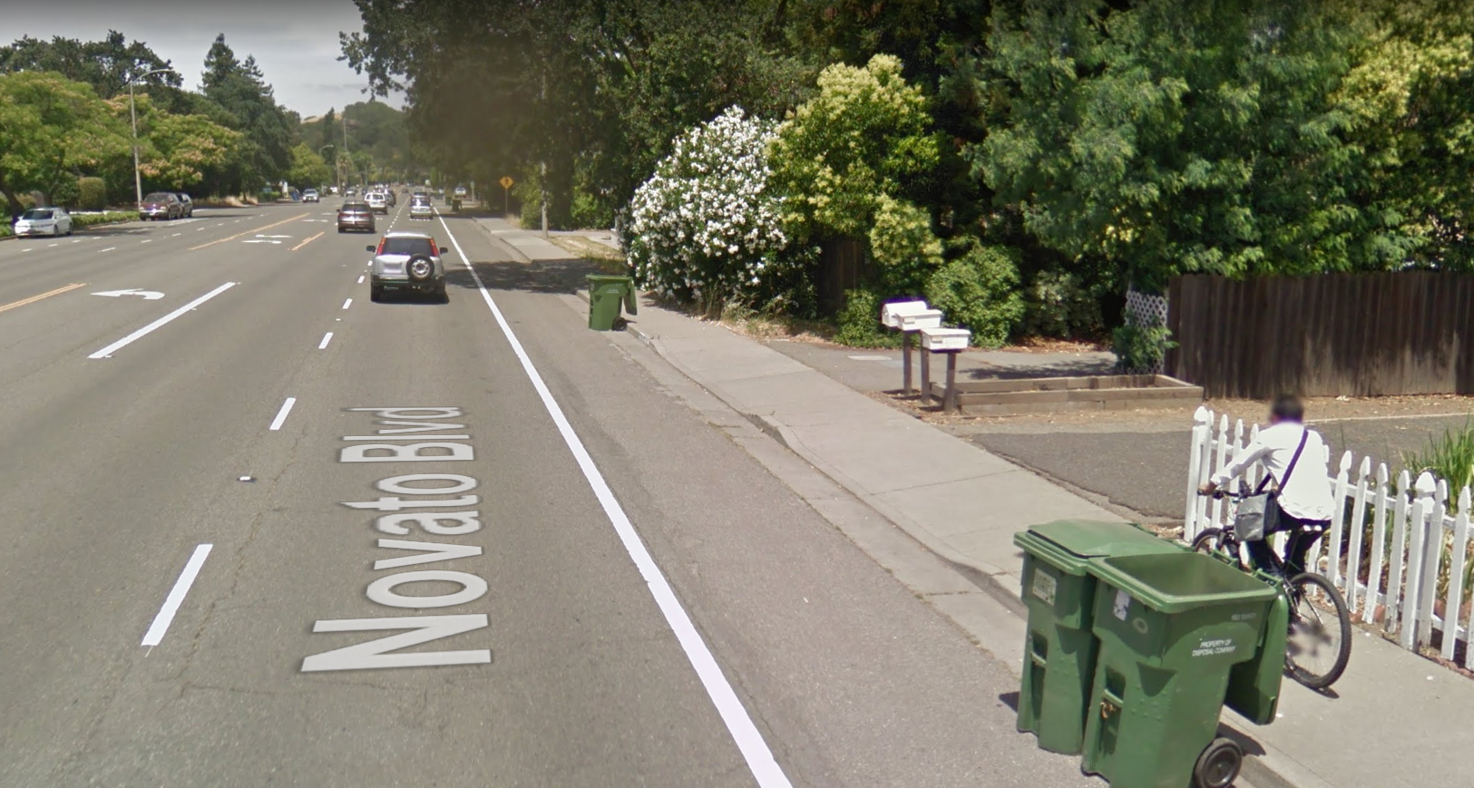 Every person riding a bike on a sidewalk is a vote for protected bike lanes. Image from Google Streetview, 2016.