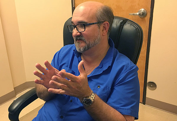 Dr. David Adair counsels a patient via video visit about managing the physical challenges of a factory job.