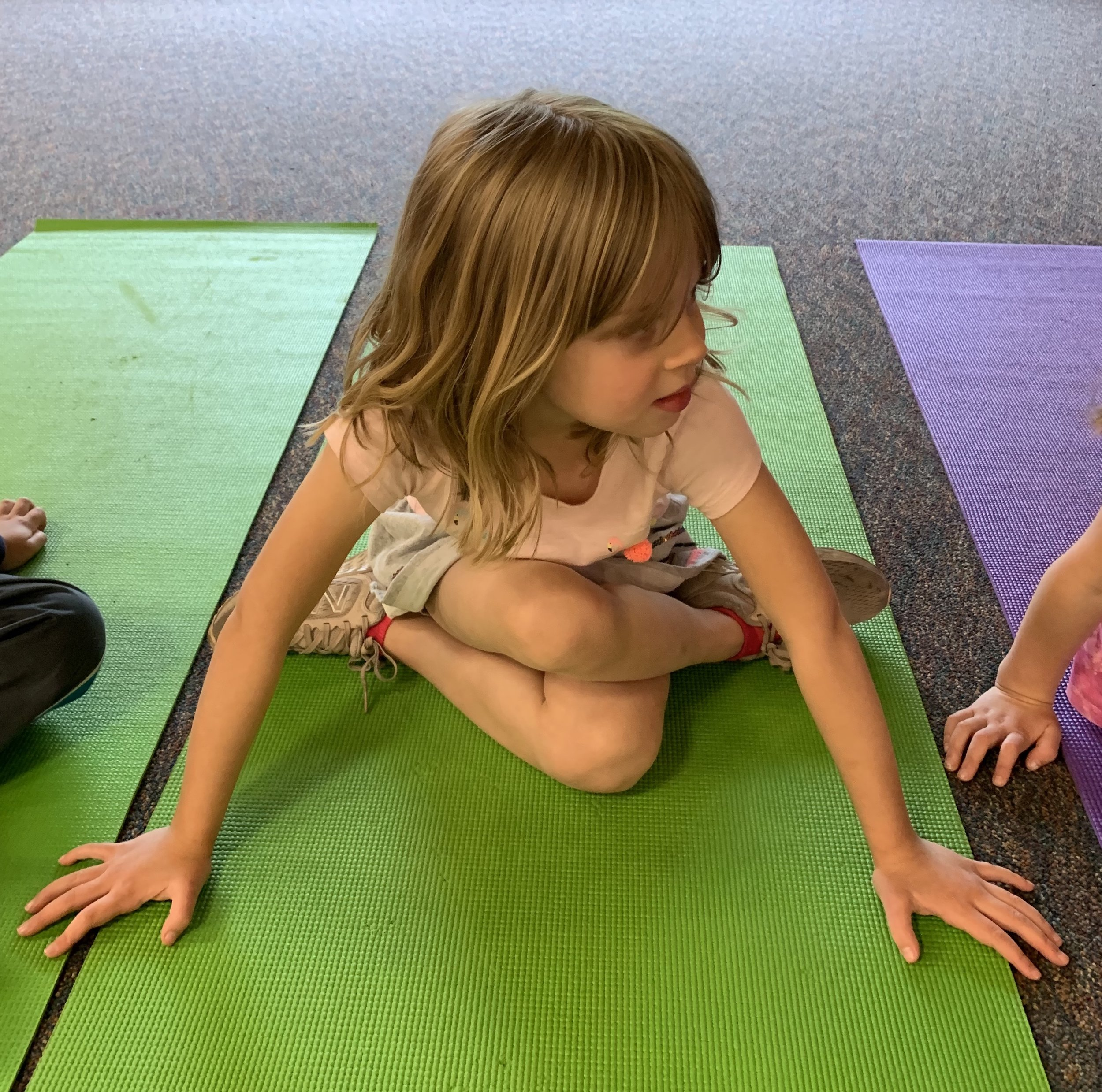 little girl criss cross applesauce yoga.jpg