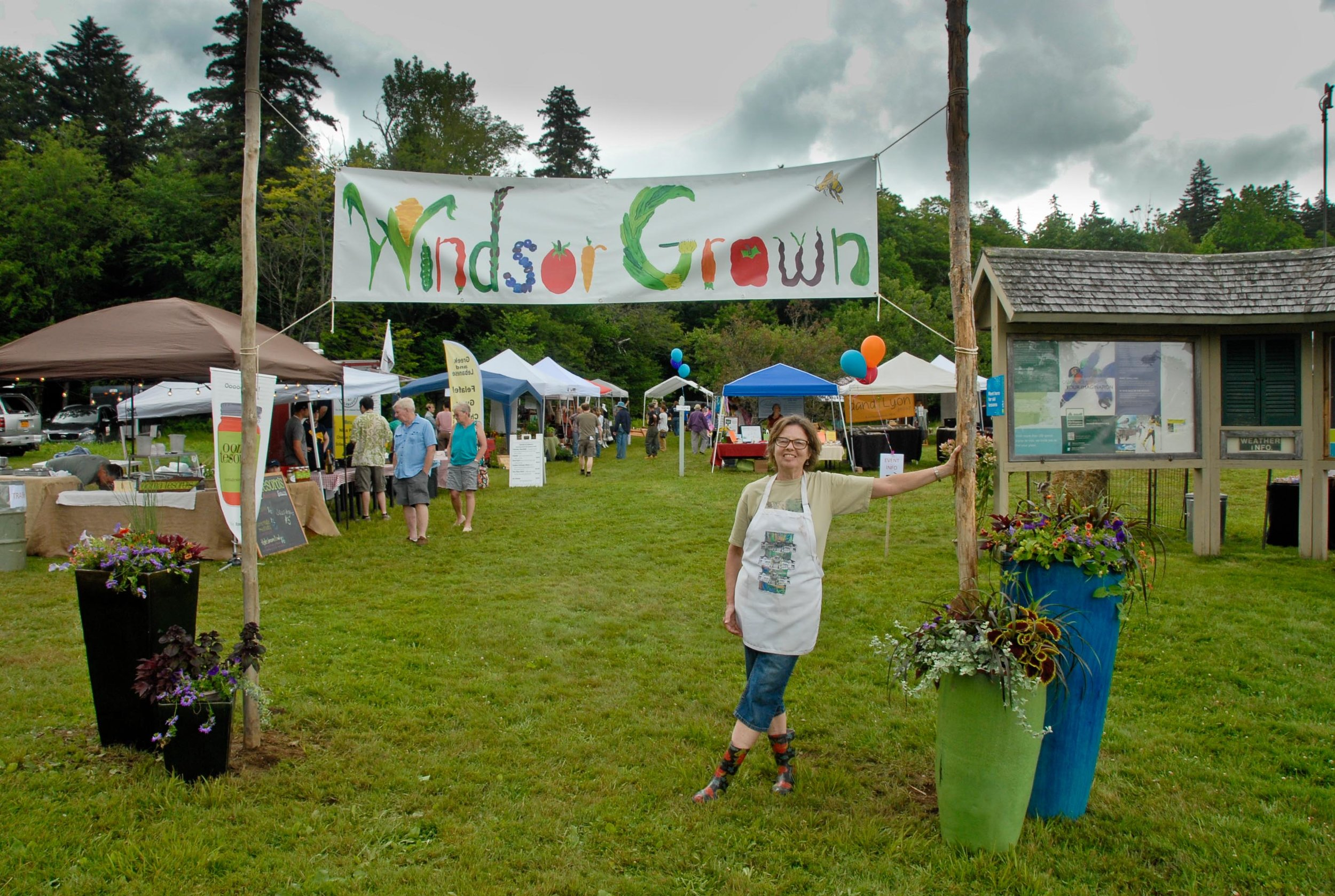 Val Kohn & her beautiful hand-painted Windsor Grown banner