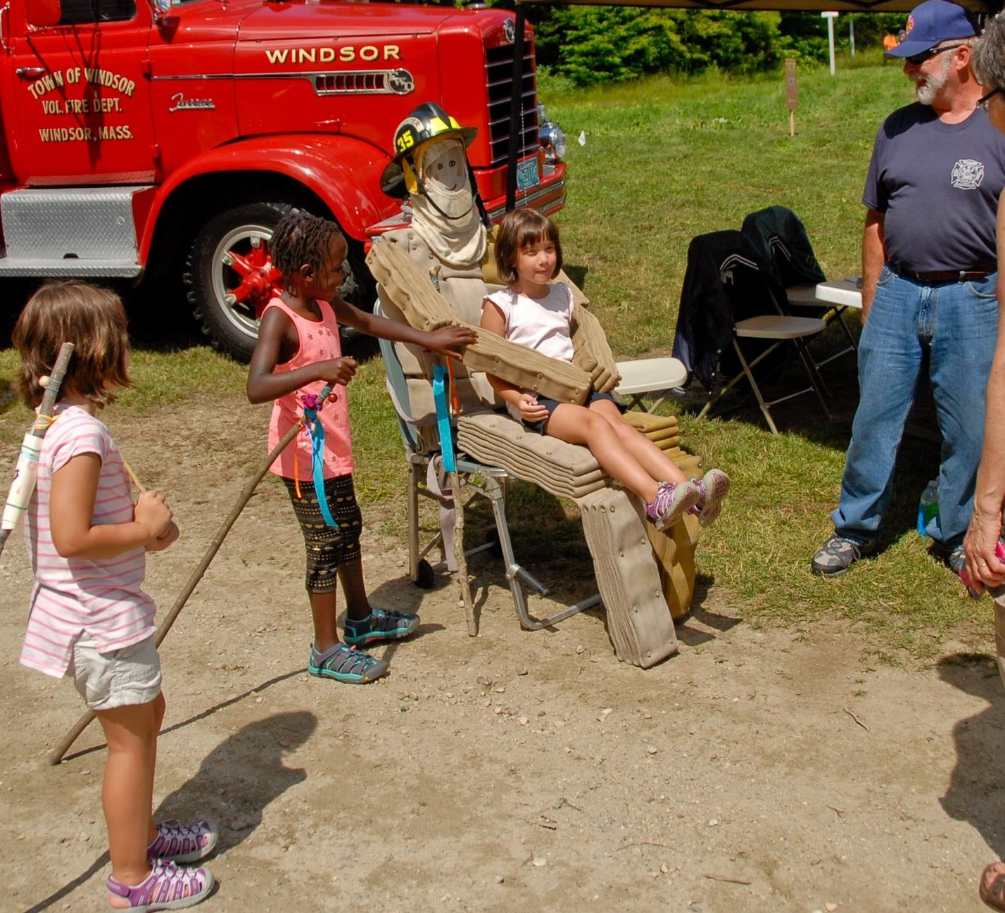 Photo Opp with Mr. Fire Hose (Charlie Riley looking on)