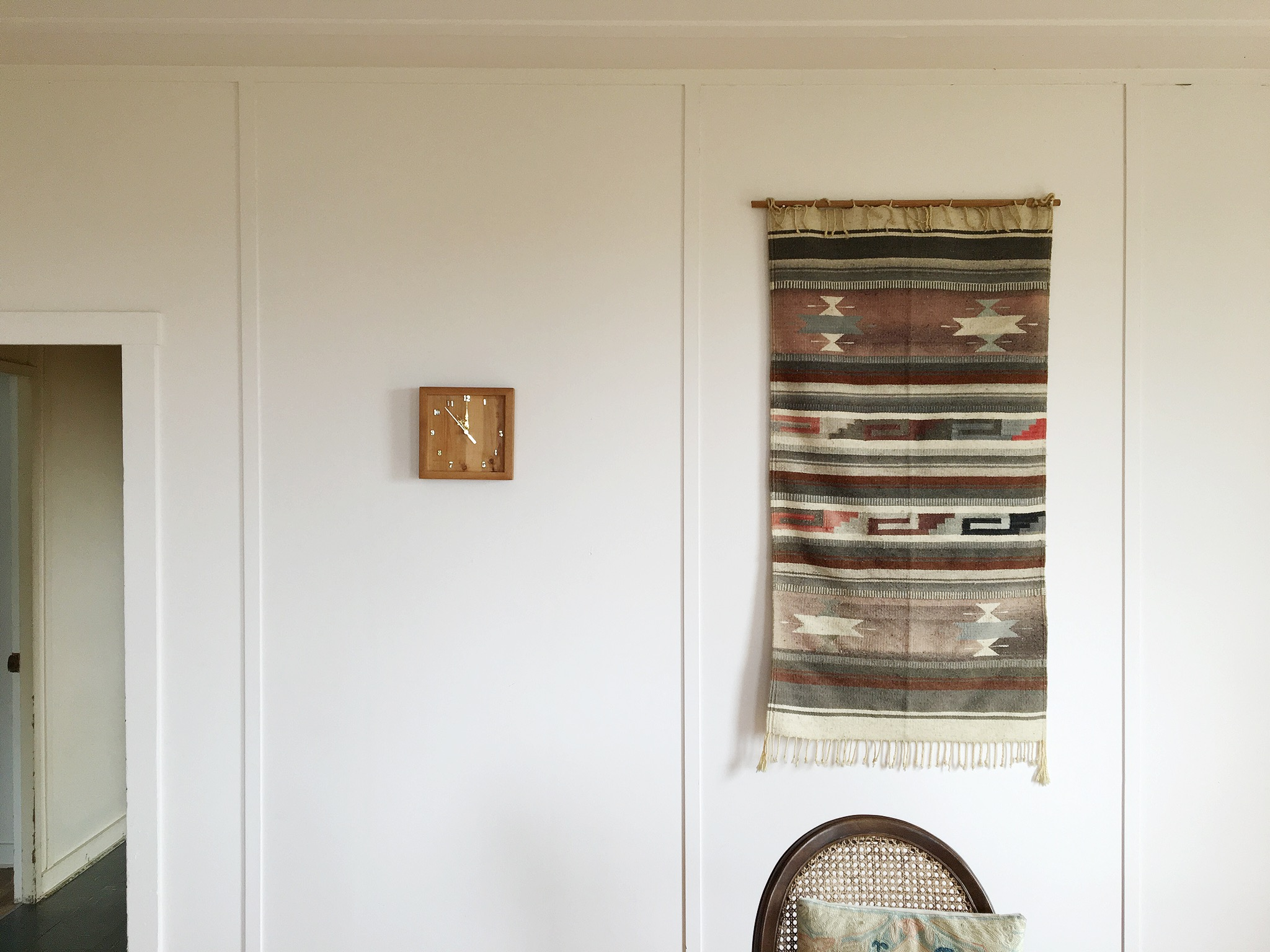 Midcentury clock plus a woven wall-hanging. There's an energy to these pairings. Vibrant and relaxed, chic and comfortable.