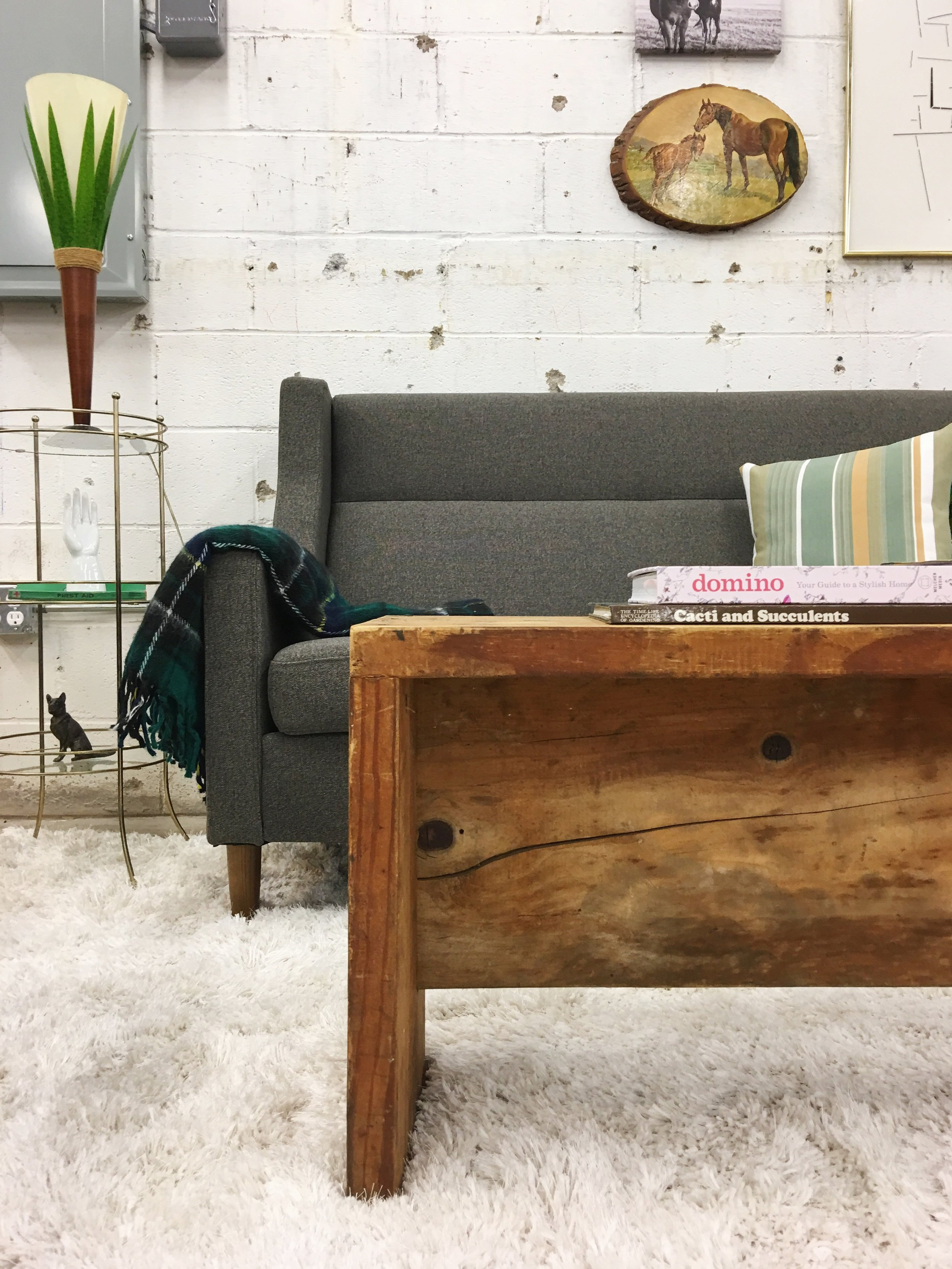 Maximalist: The warm and cozy vibe has been turned up here with a vintage wool blanket and knick-knacks with personality.