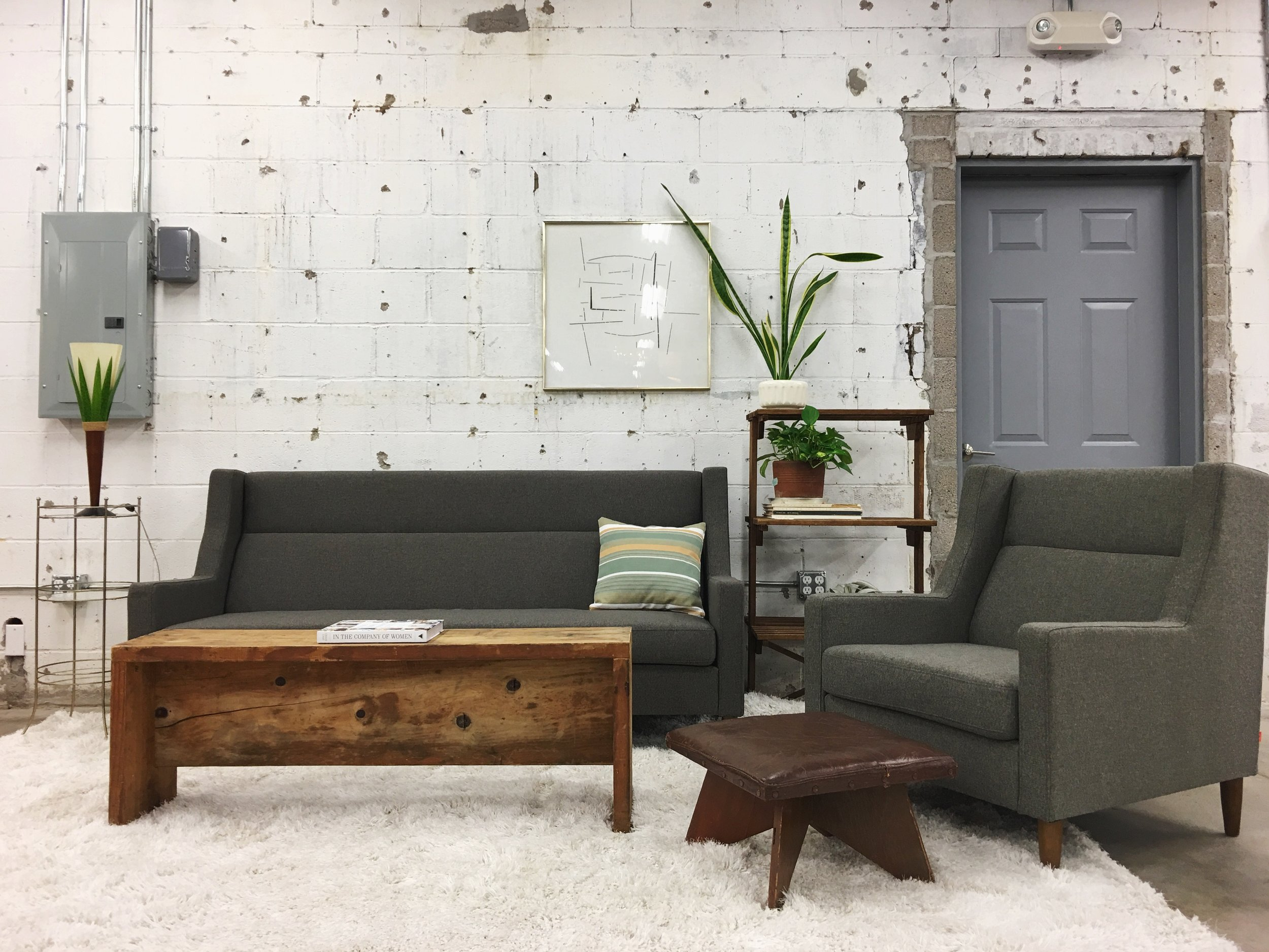 We've brought in only the necessities. A grass lamp, a couple plants, and places to sit and to prop your feet–that's it!