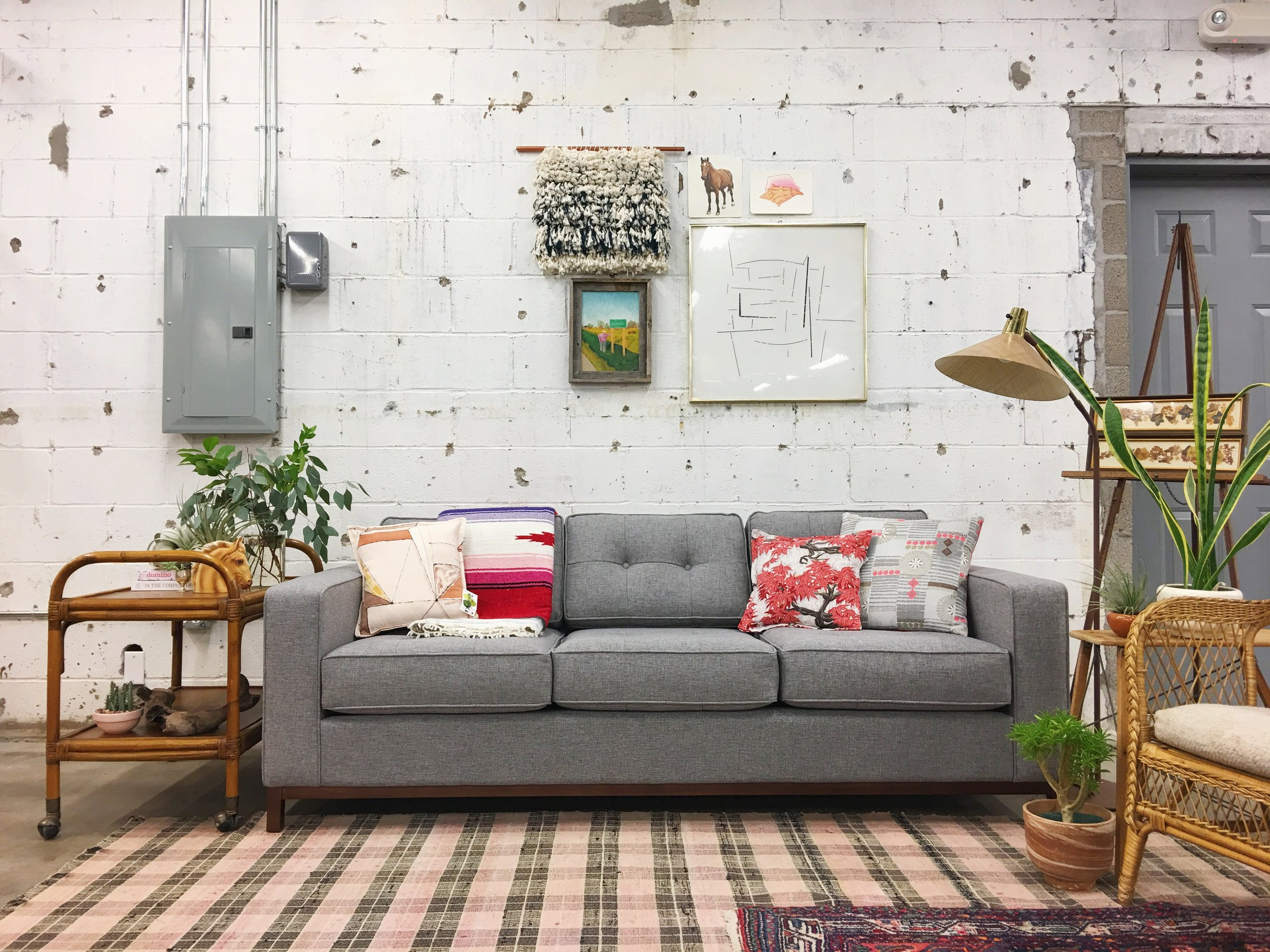 The colorful, playful bohemian elements (wicker, rattan, wall weavings) contrast nicely with the modern  Gus* Jane sofa .