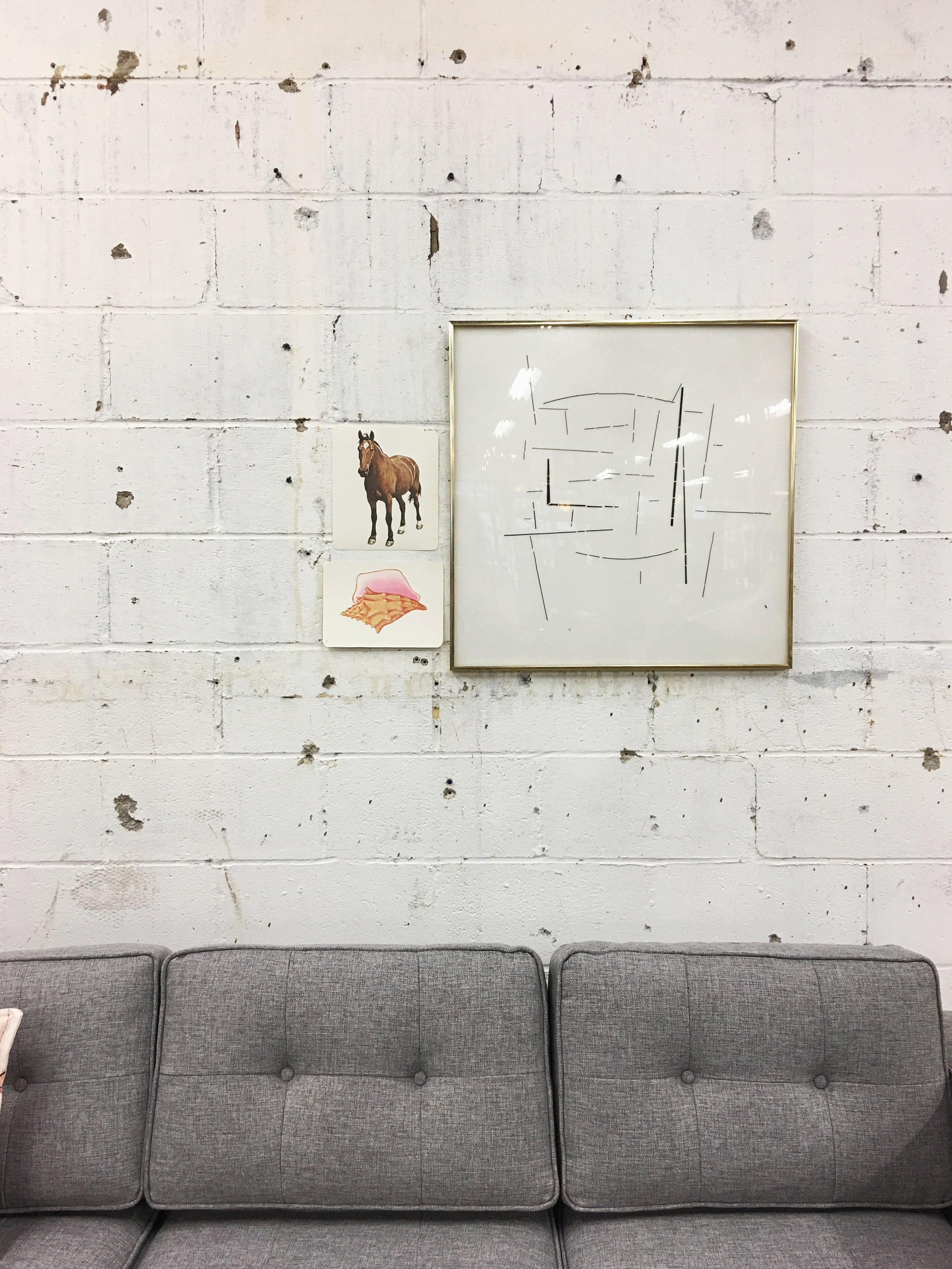Minimalist: A simple gallery wall with framed abstract art along with vintage flash cards. Would a true minimalist have only one piece?