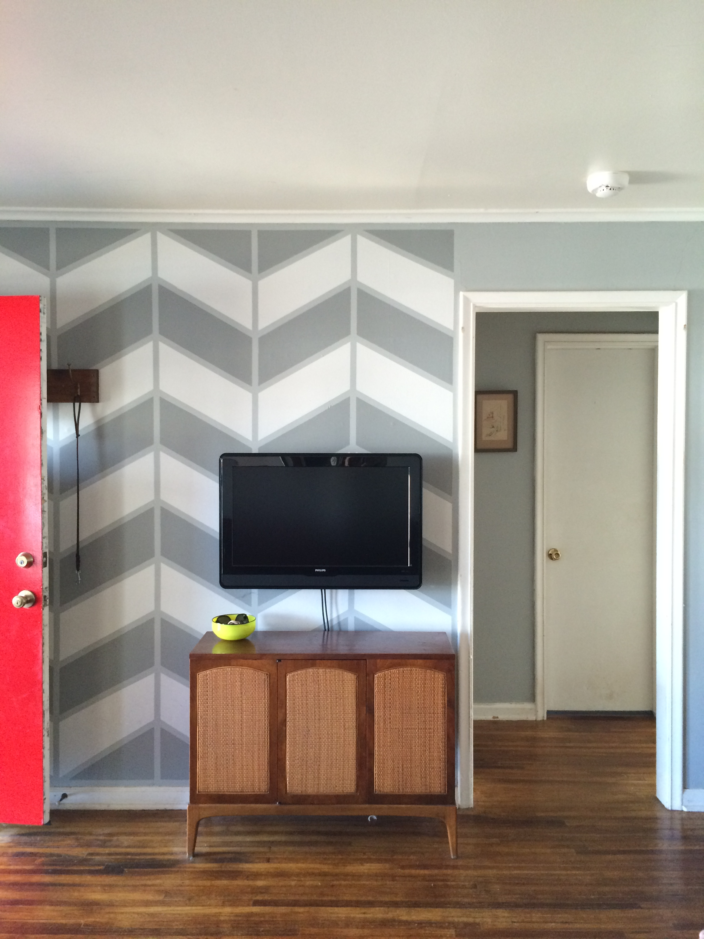 See how happy that wall is?  Making a statement decorating decision speaks over daily necessities like a television.