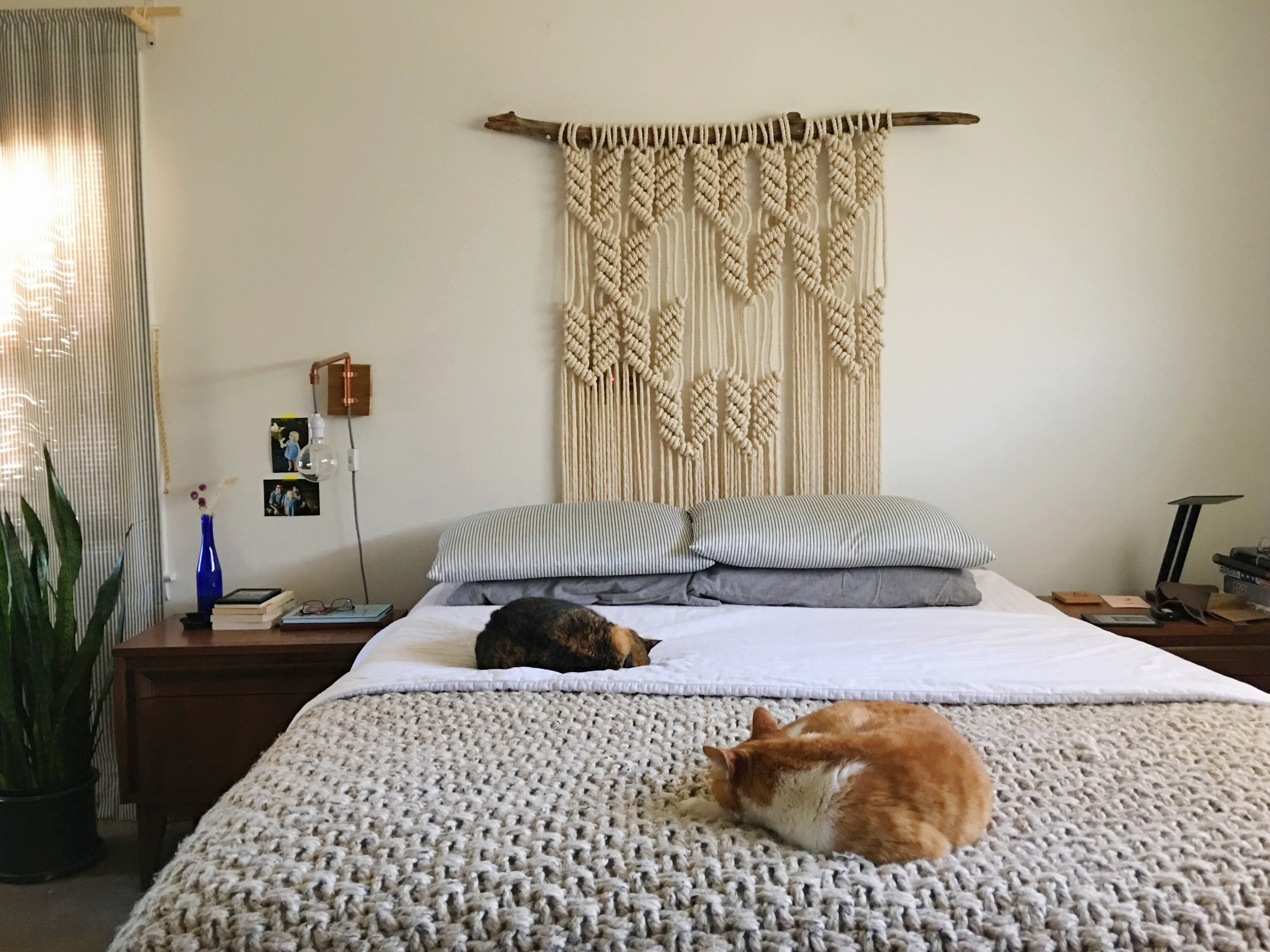 Everyone snuggled up with the winter blankets under the  House Sparrow   macrame headboard.