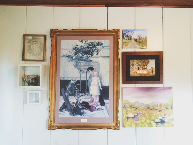 In this sunroom gallery wall, Palmer did several of the pieces herself. See more in  this before and after post.
