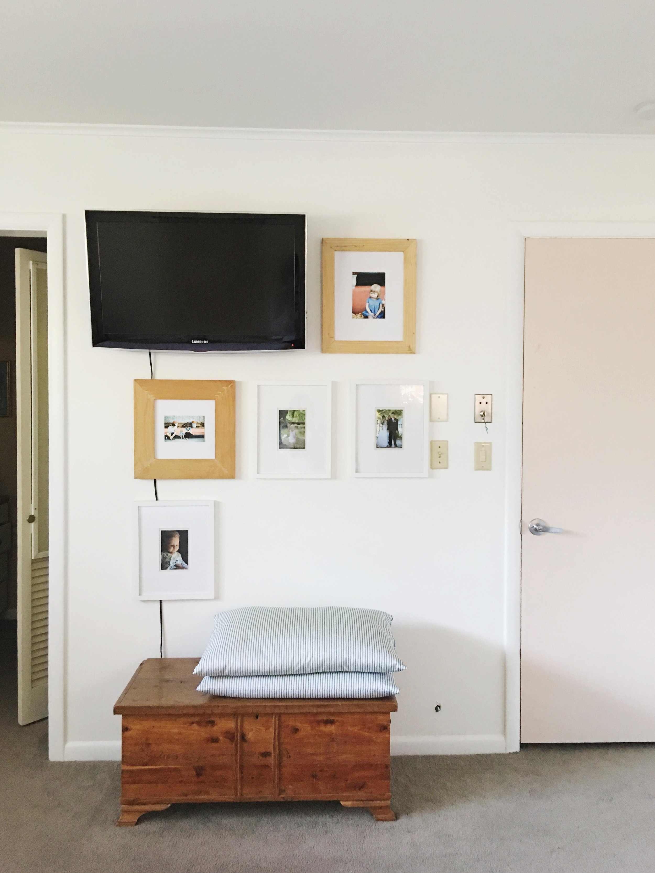 Although I still need to hide my TV cord and patch a hole in the wall, I'm on my way to a family photo gallery wall in my bedroom. I used a mix of thrift store finds and new frames. -Palmer