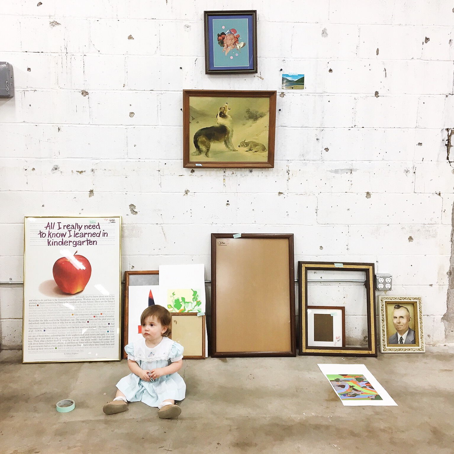 """Look at all those thrift store frames! It seems like a crime against childhood to take that """"All I need to know I learned in kindergarten"""" poster out of its frame. You should figure out what day the half-price days are, so the frames are even cheaper!"""