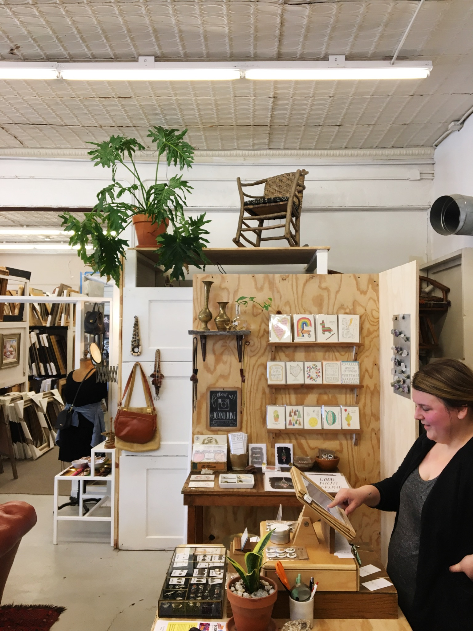 One of the owners, Danielle, adding up my tab. I got some vintage clothes that make me feel like I may run a floral booth at the farmer's market–exactly how I want to feel about myself. -Daly