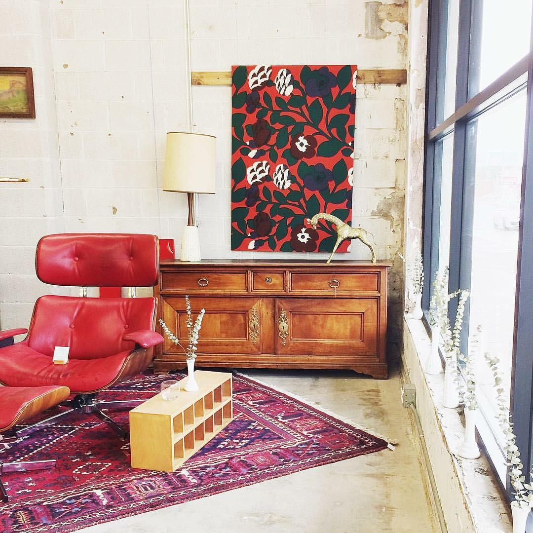 """It's like this red Plycraft chair is bringing together its beautifully patterned rug friend and its lovely floral wall hanging buddy. """"We can all be friends,"""" he says."""