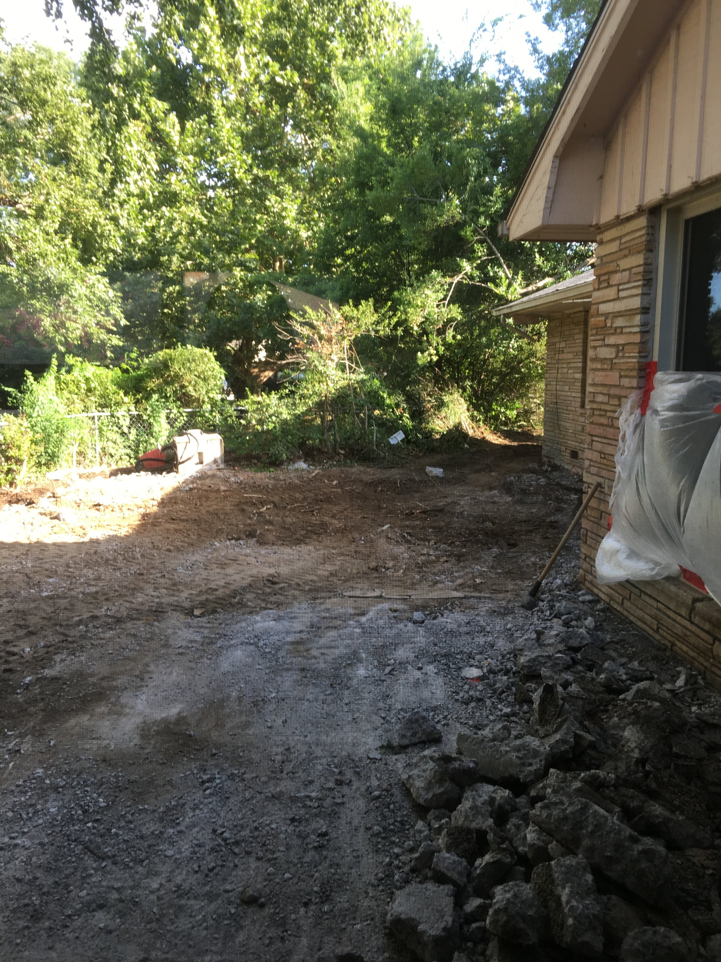 The local concrete company drove crazy machines into our backyard and demolished the patio.