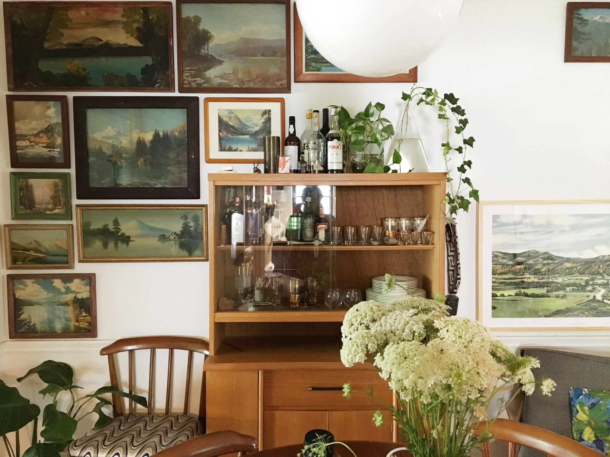 Ashley Daly is collecting vintage landscapes for her dining room wall. She didn't want to compromise for the sake of speed and plans to hang and rearrange as need be to complete this wall.