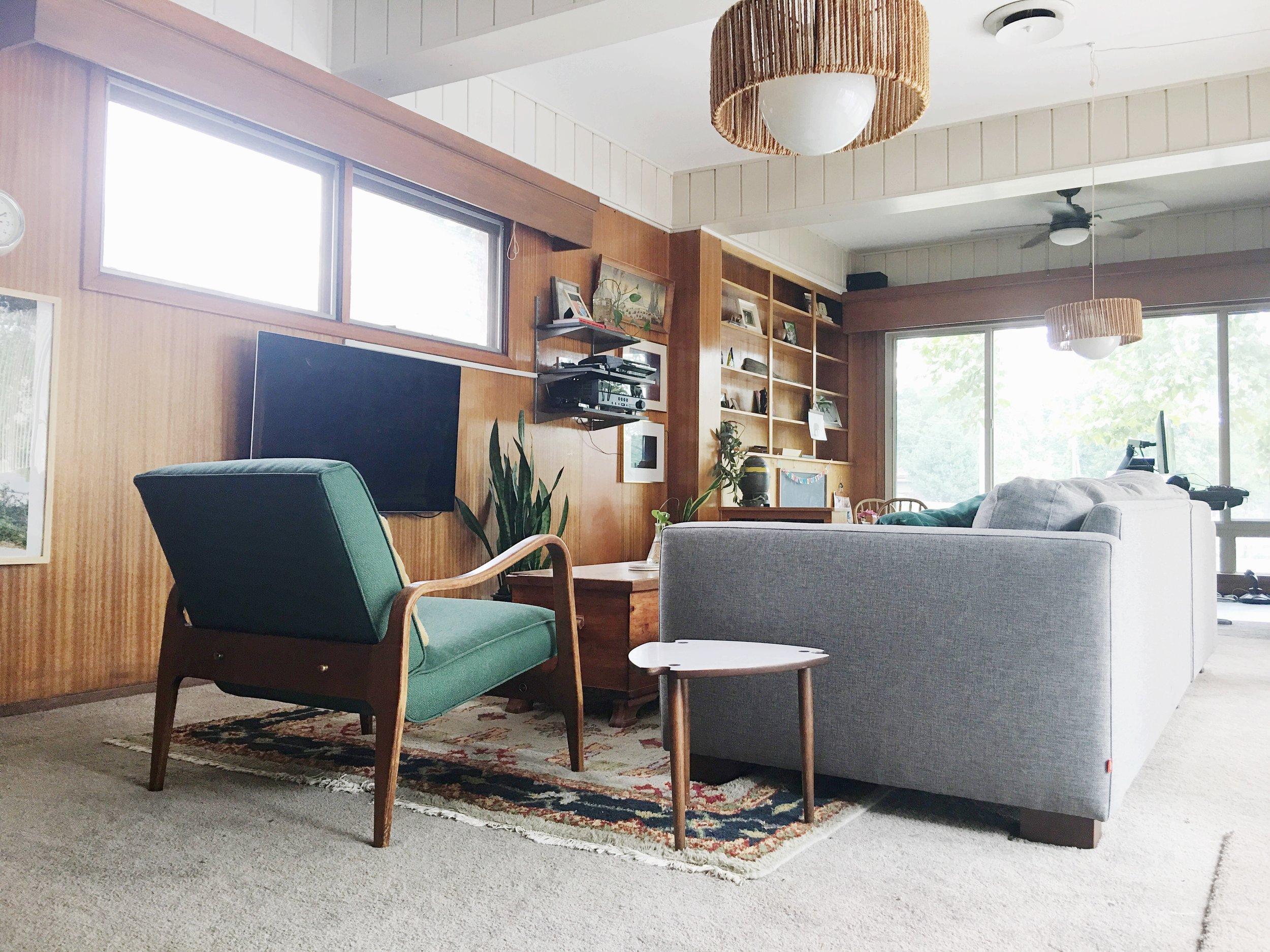 mid century modern eclectic wood paneling den