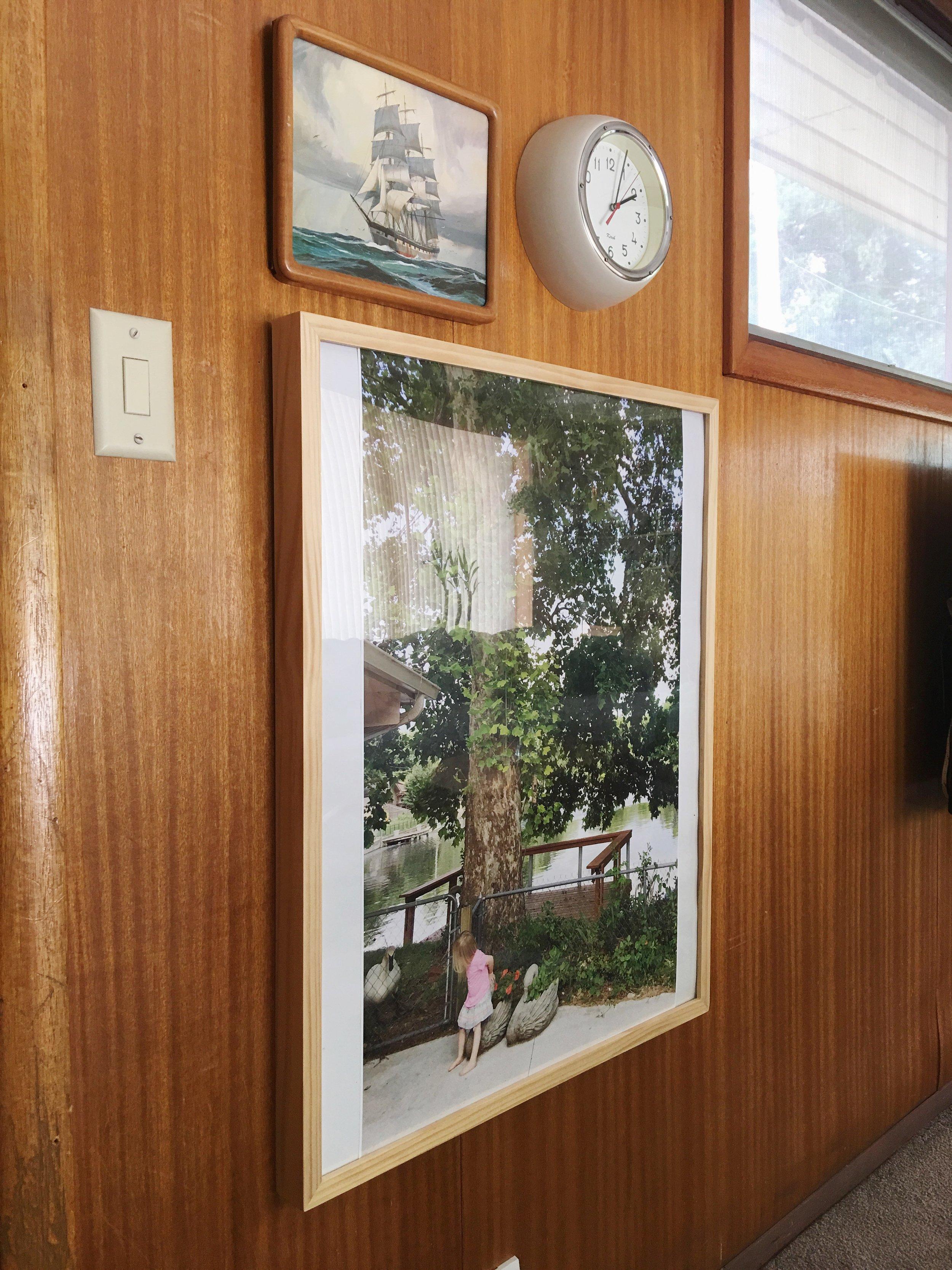 wood paneled den artwork