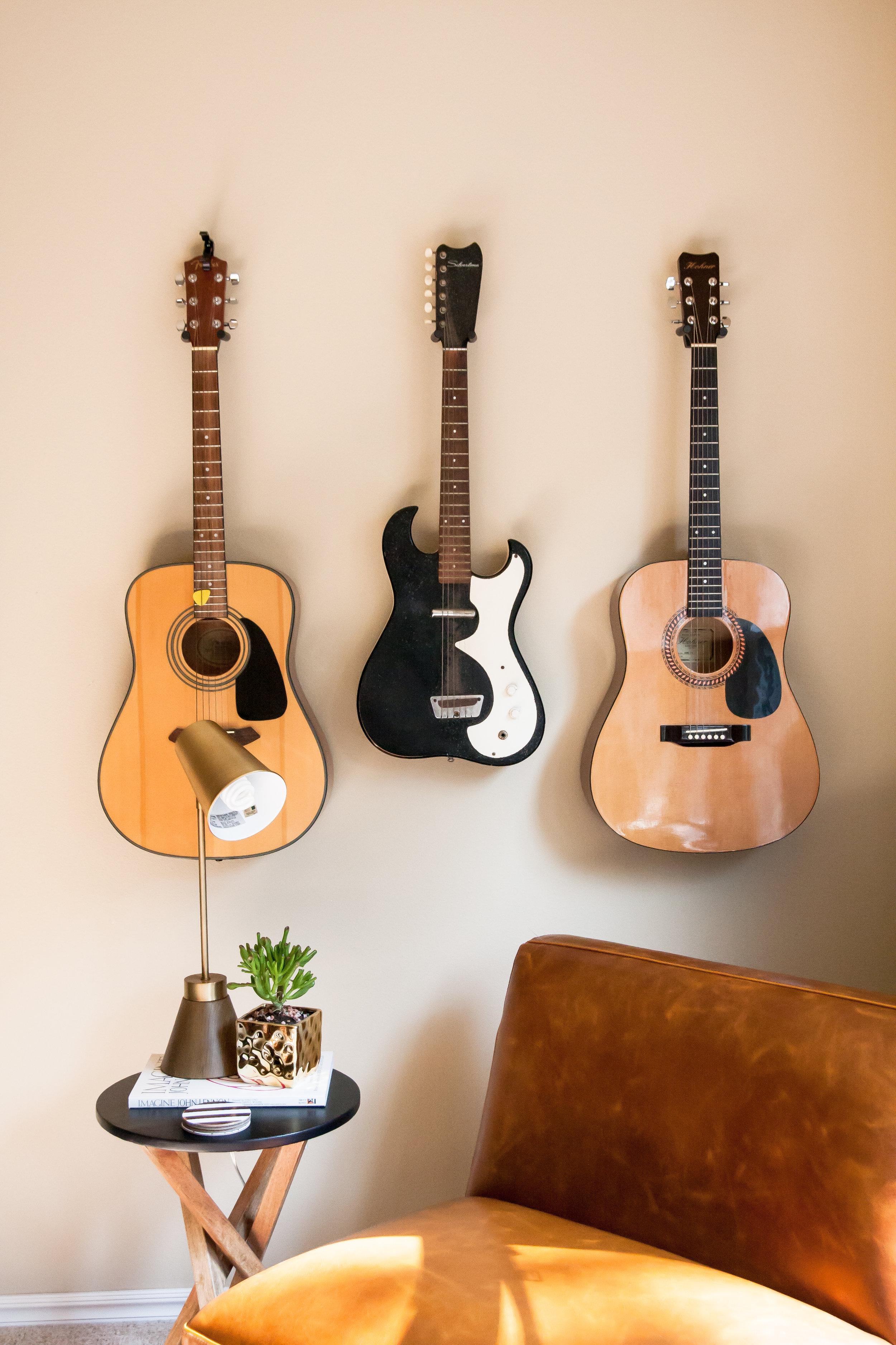 hang guitars on wall