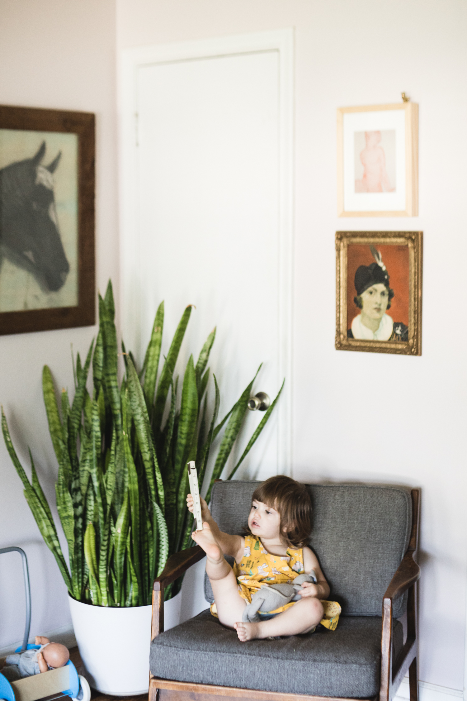 I love the art in this corner of my house. I saved the horse at a garage sale. The others are a little fancier. I like them all together. Photo credit:  Molly Thrasher