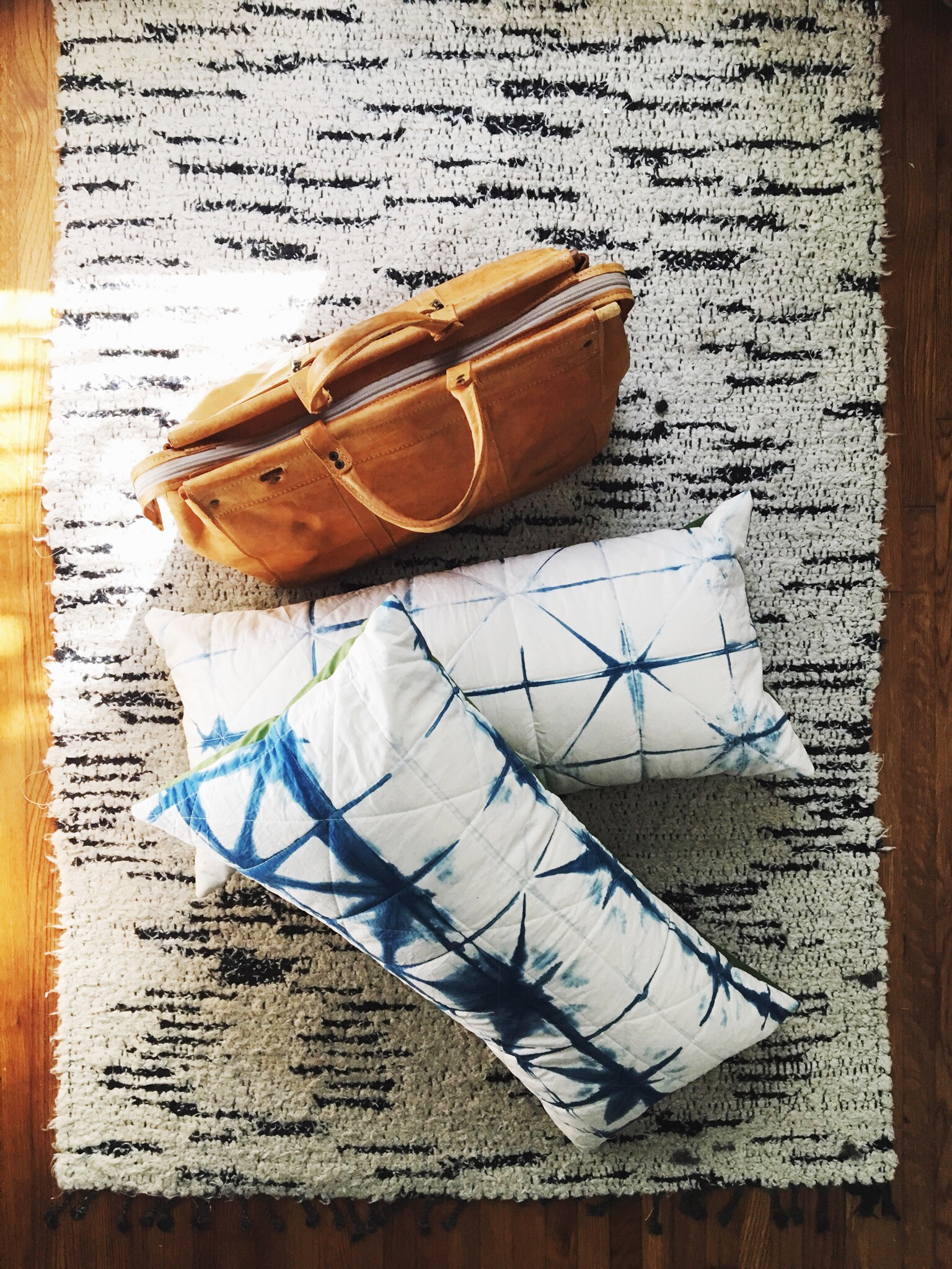 Daly made some pillows for her bed out of her  House Sparrow Fine Nesting shibori fabric she dyed herself at one of Tasha's classes!  Owl and Drum fabric and lessons to make the envelope pillows and to quilt the fronts. Sewing retreats make dreams come true.
