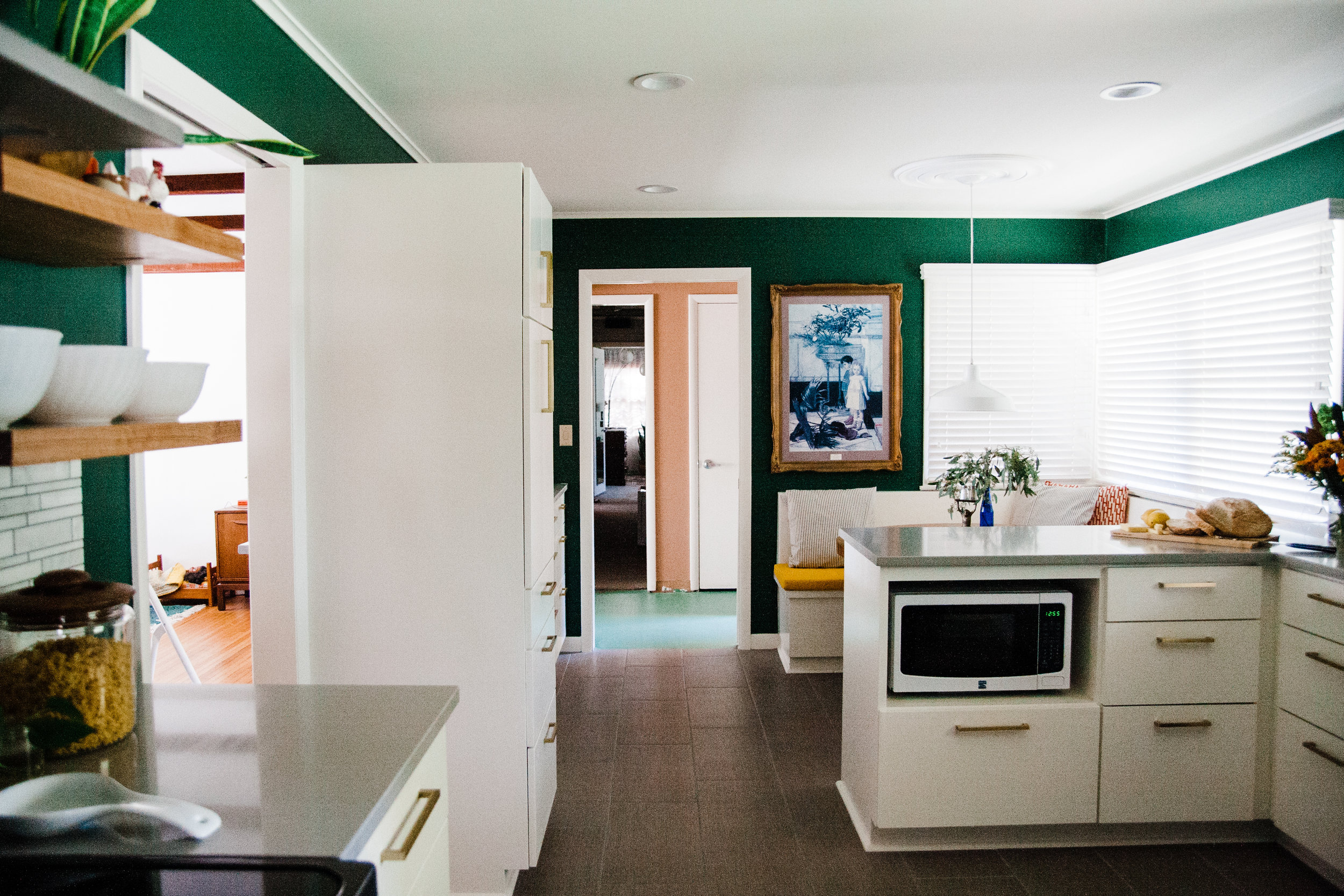 See that tall column of cabinets to the left just past the door? That's the new pantry.
