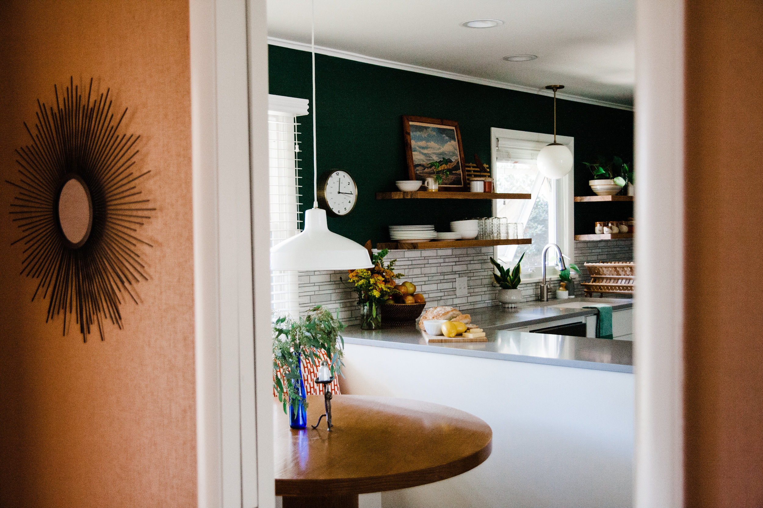 Here's a peak into the kitchen from the entry way. I painted the entryway peach to match the mudroom (on the other end of the kitchen).
