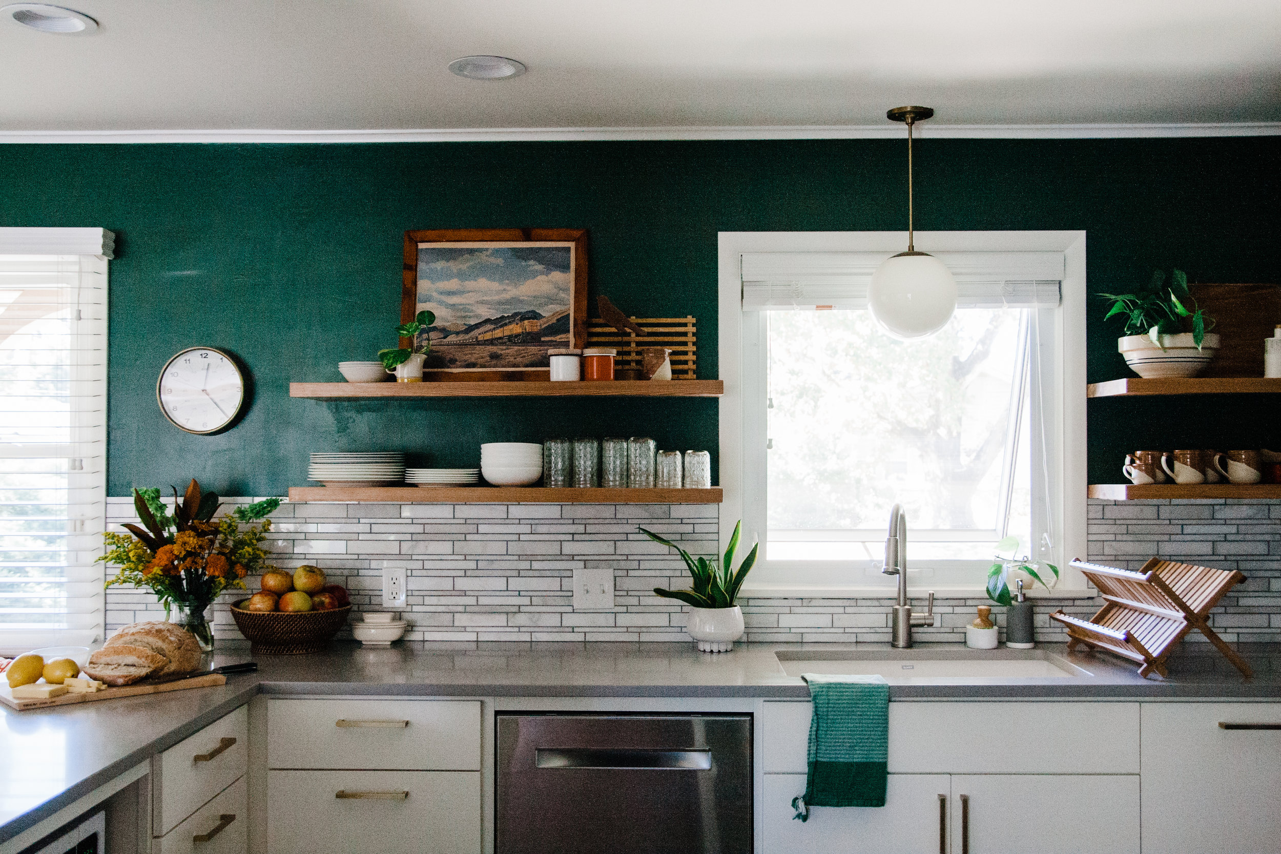 During our design consultation with Ashley Whiteside, she recommended this beautiful backsplash that mimics the stone of our fireplace and home exterior. Thank you, Whiteside!