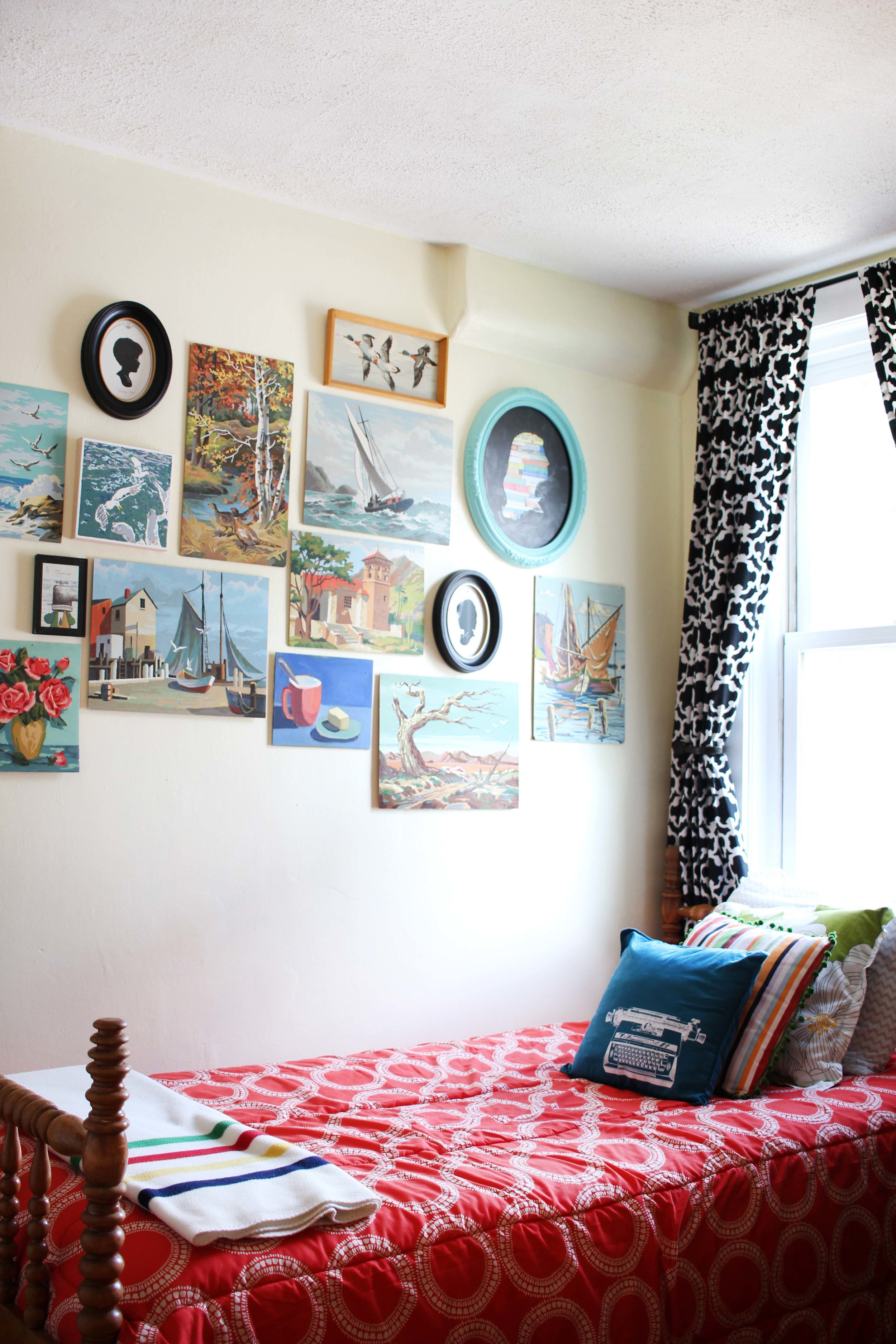 Zandra your guestroom's gallery wall is doing it for us. We'll come stay here.