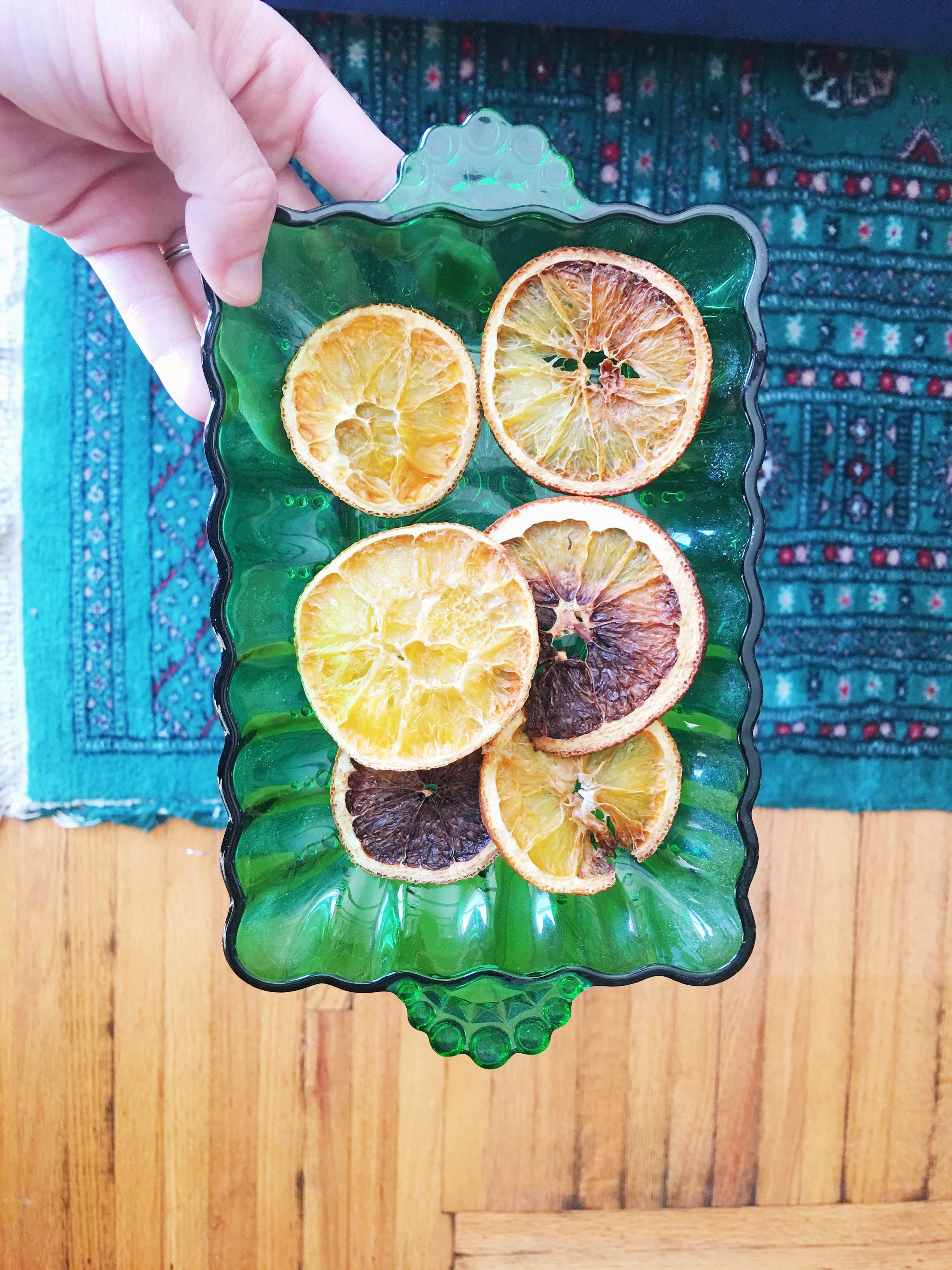The slightly too burned oranges live in a pretty green tray.