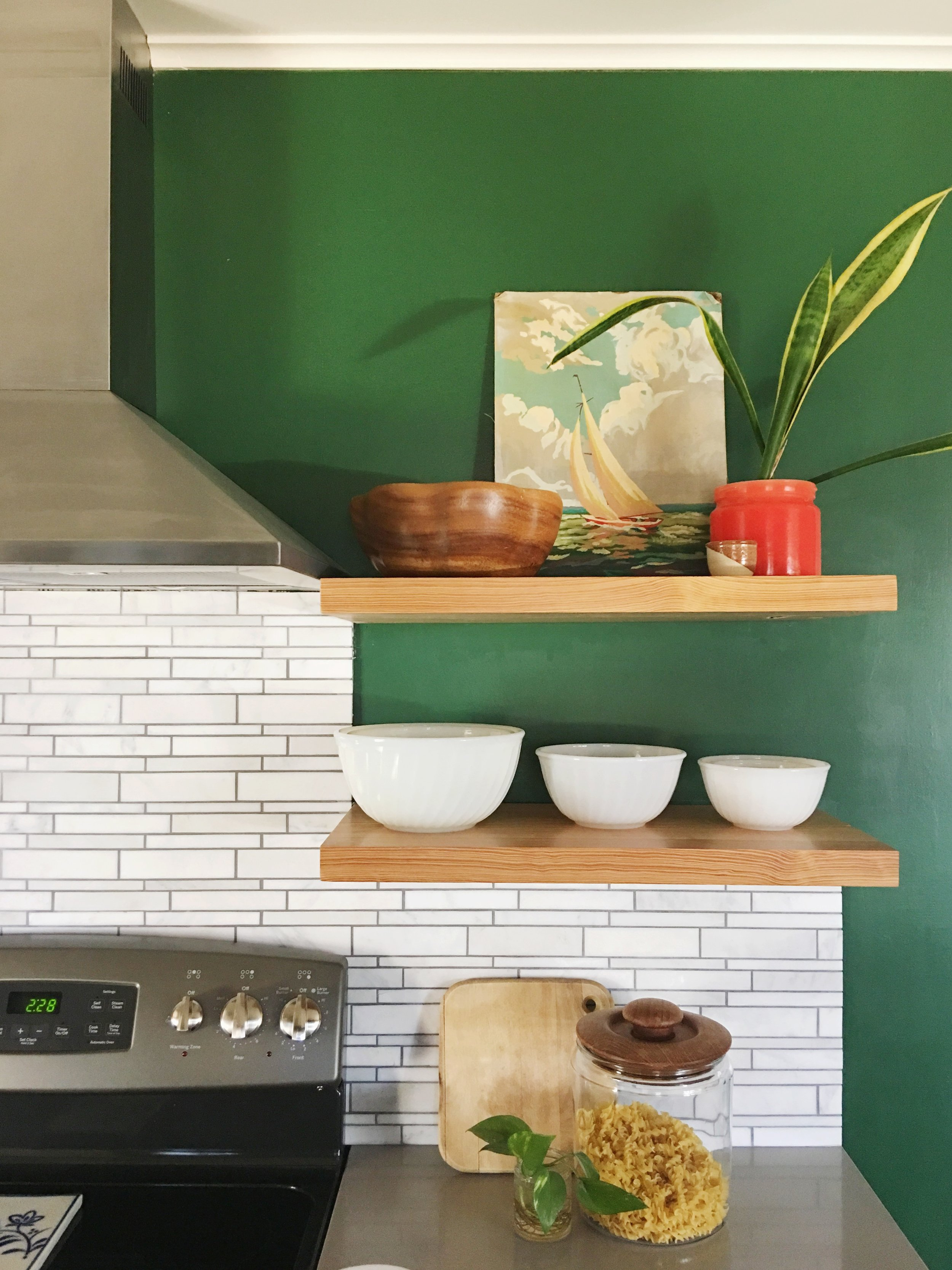 Palmer also added a vintage paint by numbers sailboat to her kitchen shelves this week. Those colors!