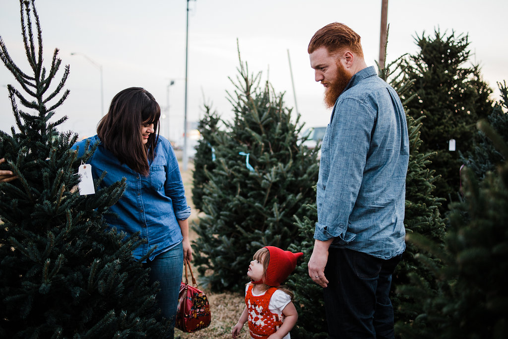 Us looking for our Christmas Tree at Carmichael's Produce. Photo:  You Are Photo Co. Why is my Ryan so angry at the tree? :-)