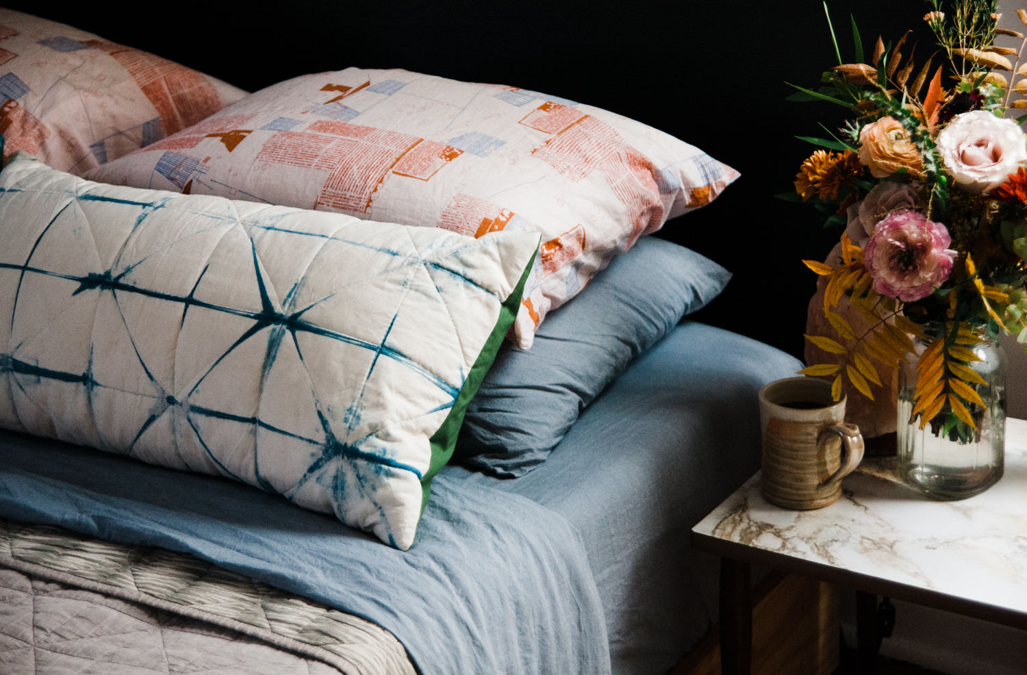 Much like making fire, creating your own warm, comforting and useful bedding is empowering. It also leaves you feeling your place in a long line of makers throughout history. It's a satisfying tradition to be a part of. That Carolyn Friedlander fabric is SO lovely. I marvel at the way it is geometric and organic all at once.