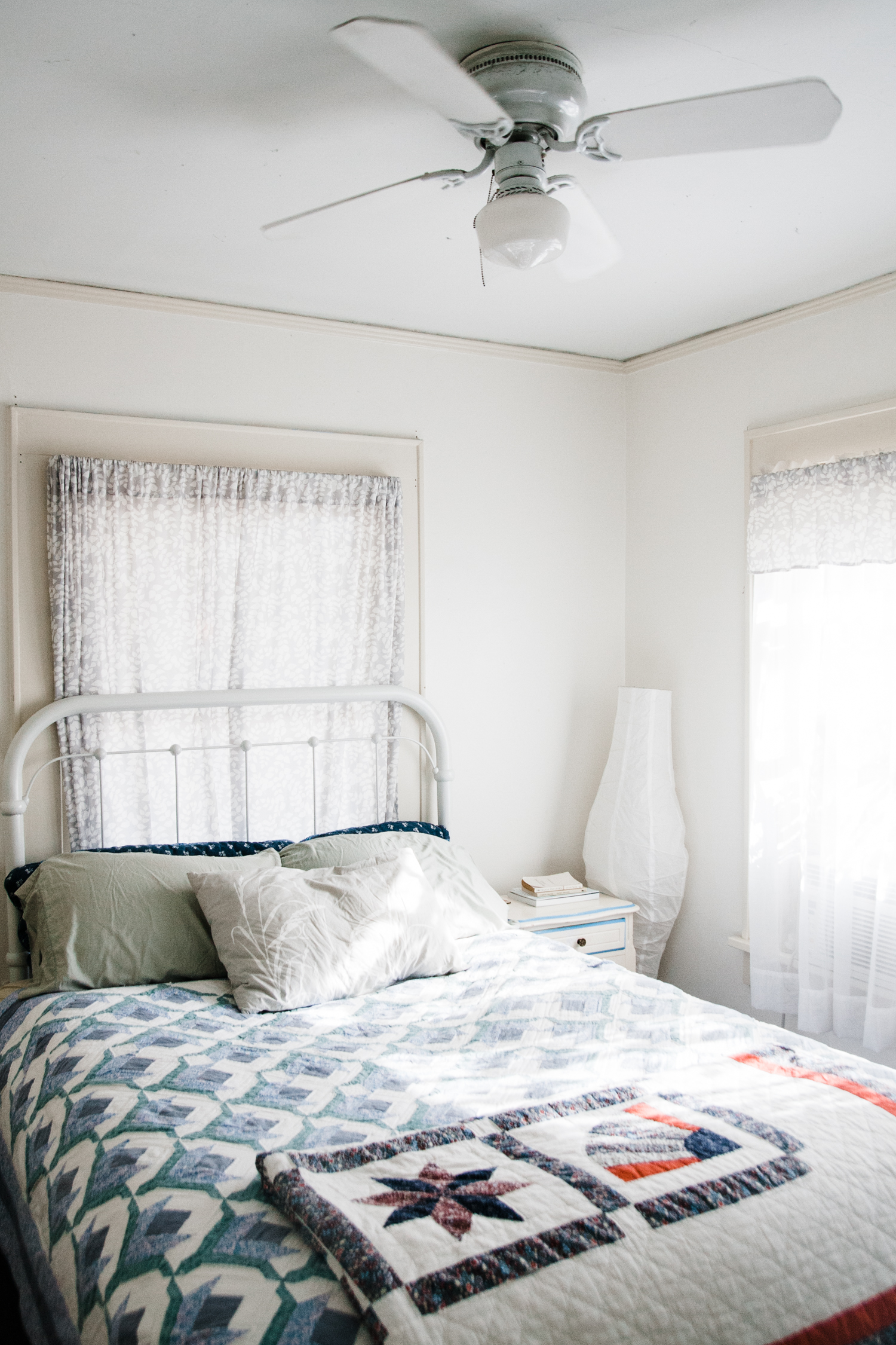Emily's bedroom is small, but beautiful, adorned with vintage quilts.