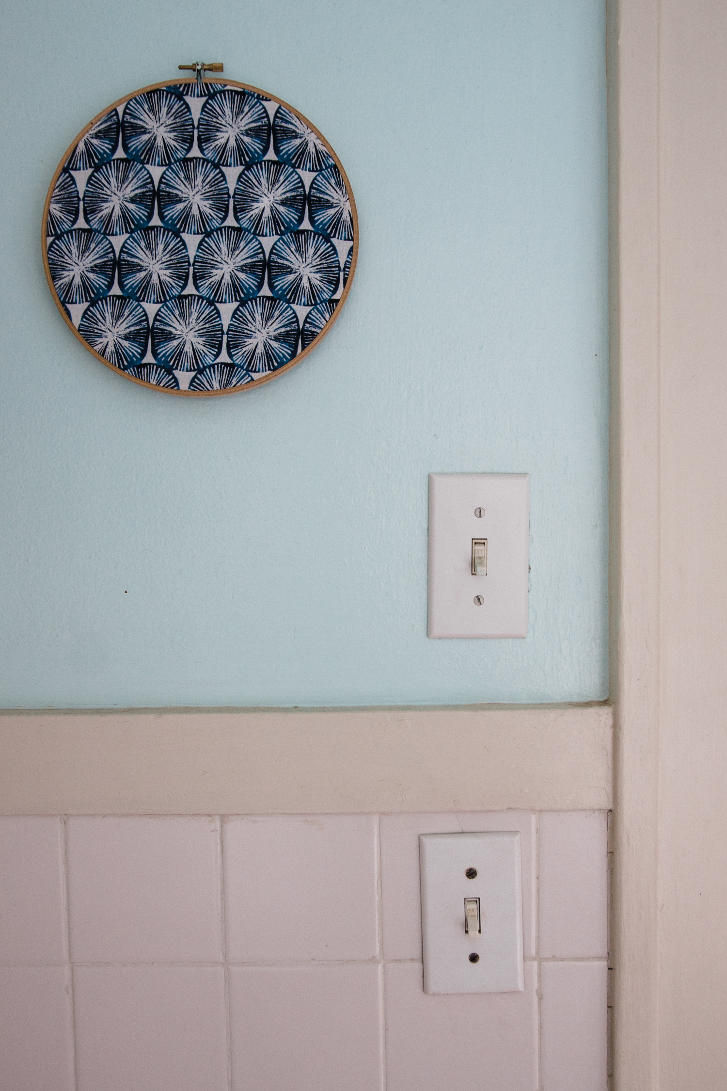 Emily uses Owl & Drum fabric in an embroidery hoop as artwork in her bathroom.