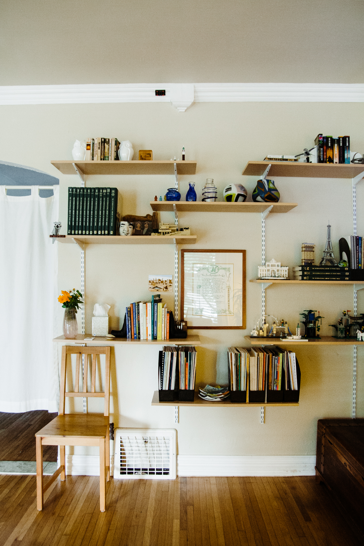 We loved that the knick knacks on the new wall-mounted shelves represented this charming couple so well– Angeline's hand-blown glass pieces and William's Lego sets!