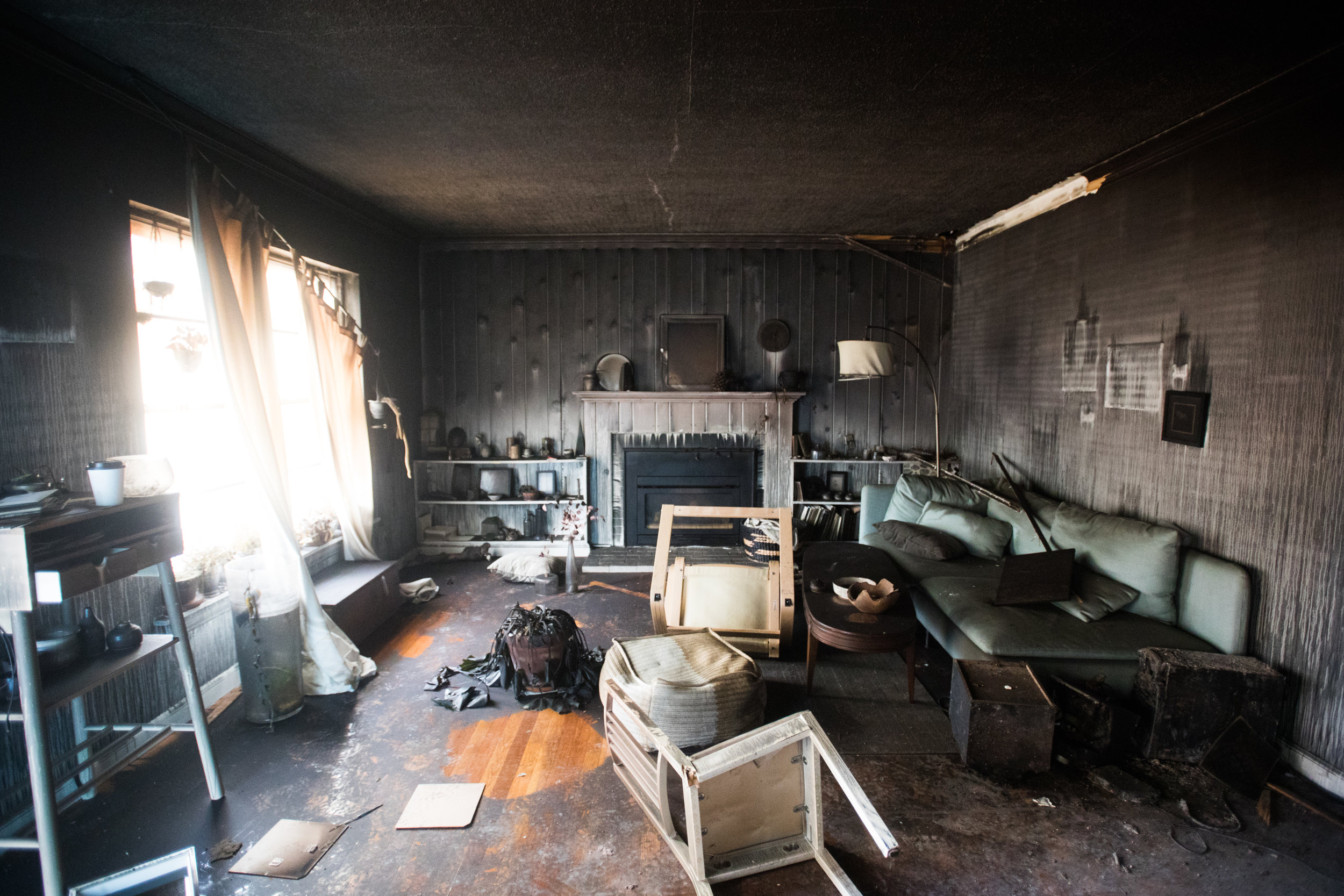 Molly captured the devastation of their home fire last year.