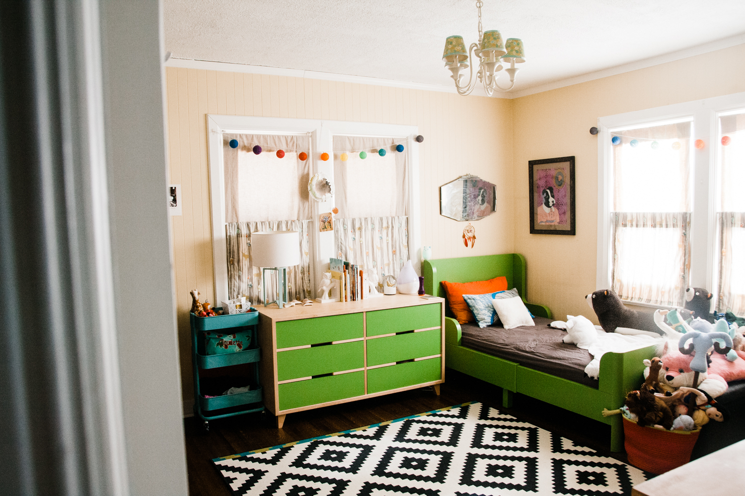 Claudette's room is so bright, colorful and filled with meaningful artwork and family photos. Also, lucky girl, her grandfather built her bedroom furniture!
