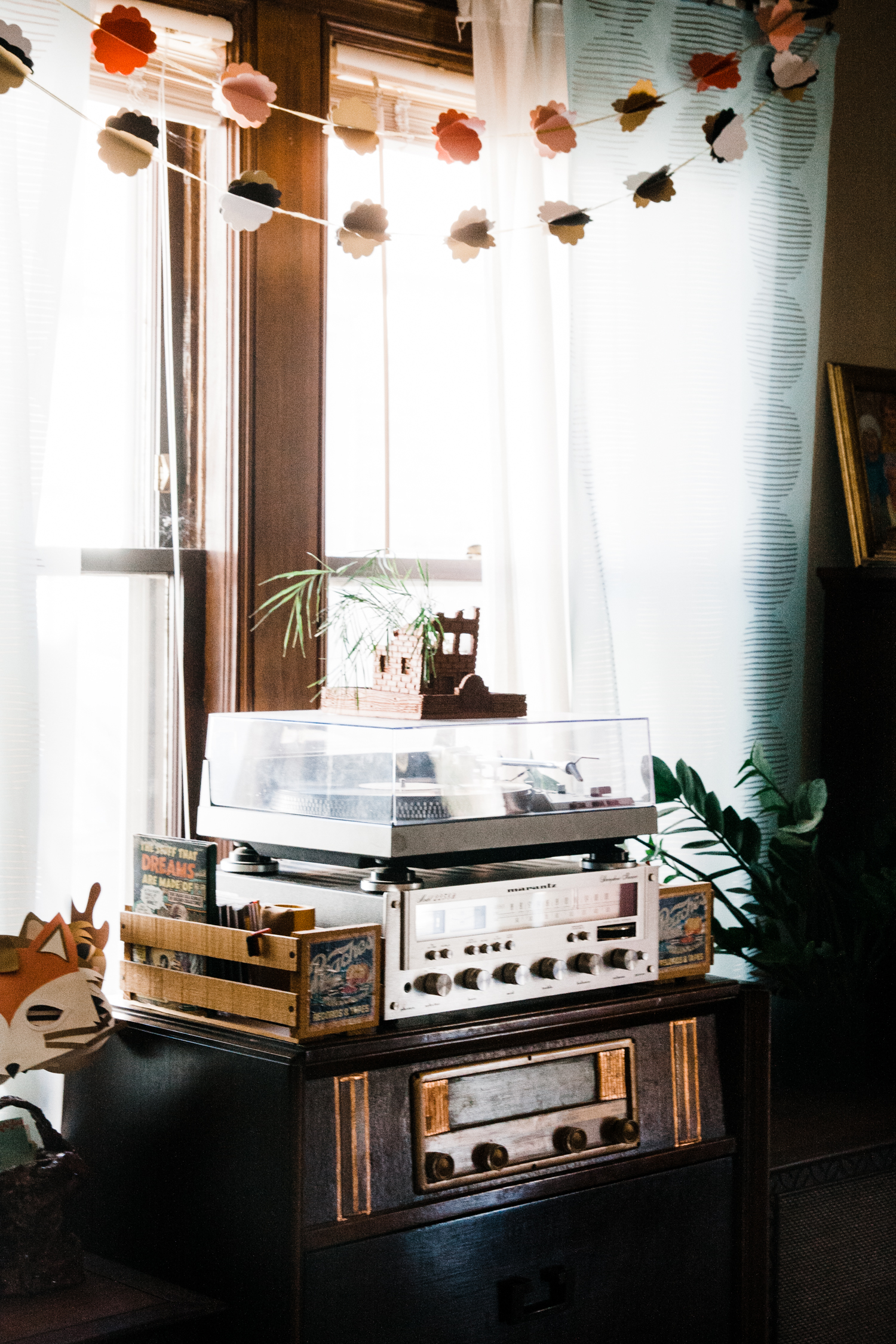Allison made the crumbling building planter that sits atop the record player.